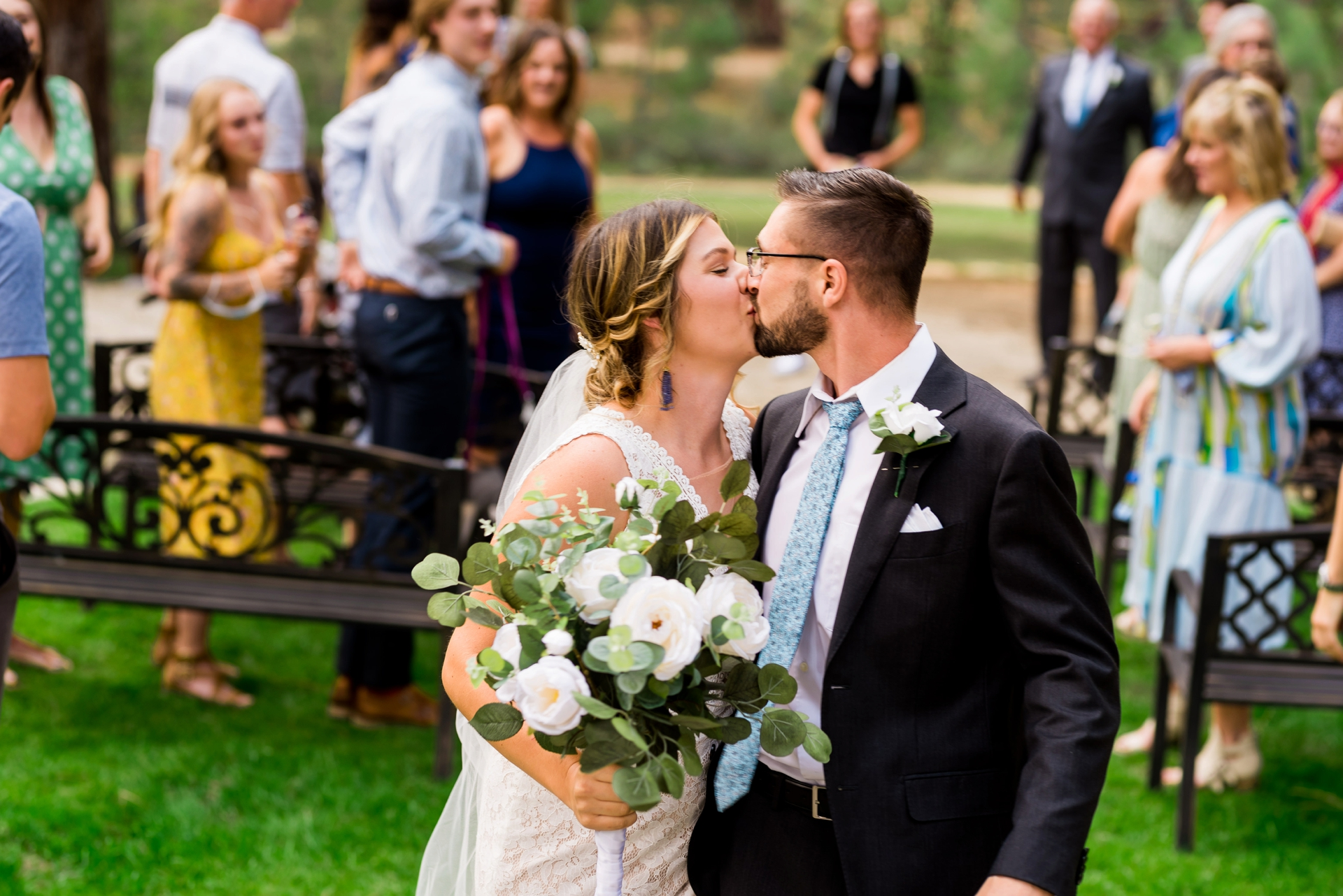 Demonstration Gardens of Lake Tahoe CC Wedding Photo | The couple recede down the aisle and share a kiss