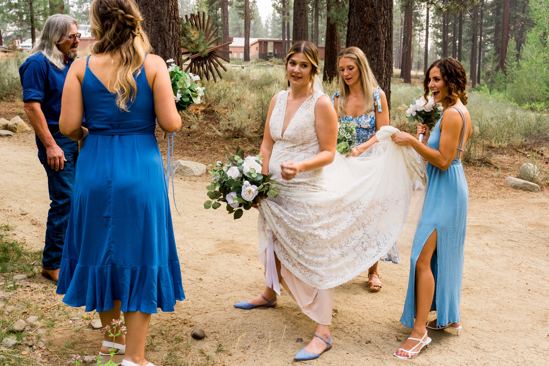 LTCC, South Lake Tahoe CA Wedding Photography | The wedding party tries to assist the bride by cooling her off