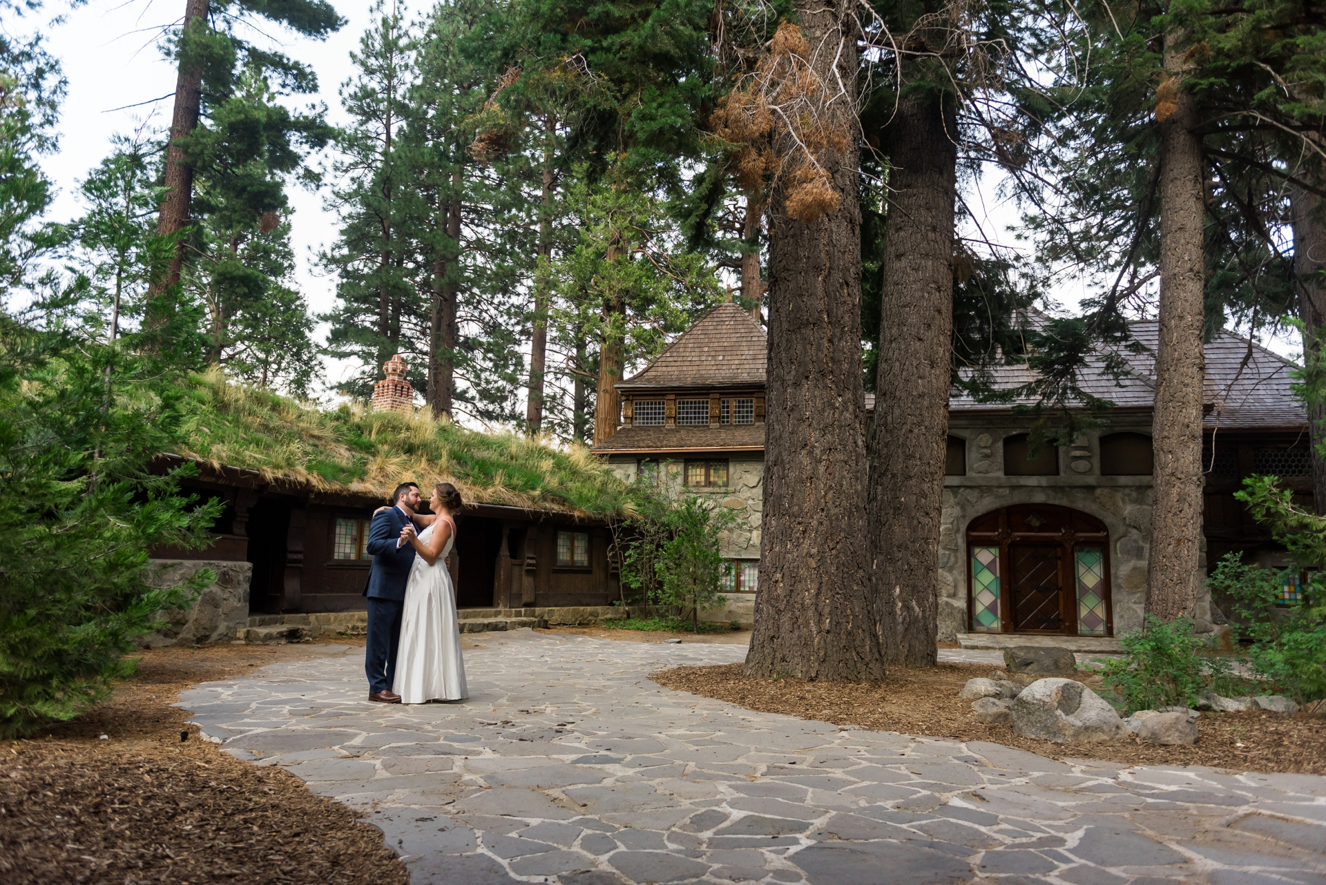 Vikingsholm Castle, Emerald Bay, South Lake Tahoe CA Wedding Pics | The bride and groom share a moment while dancing in the courtyard