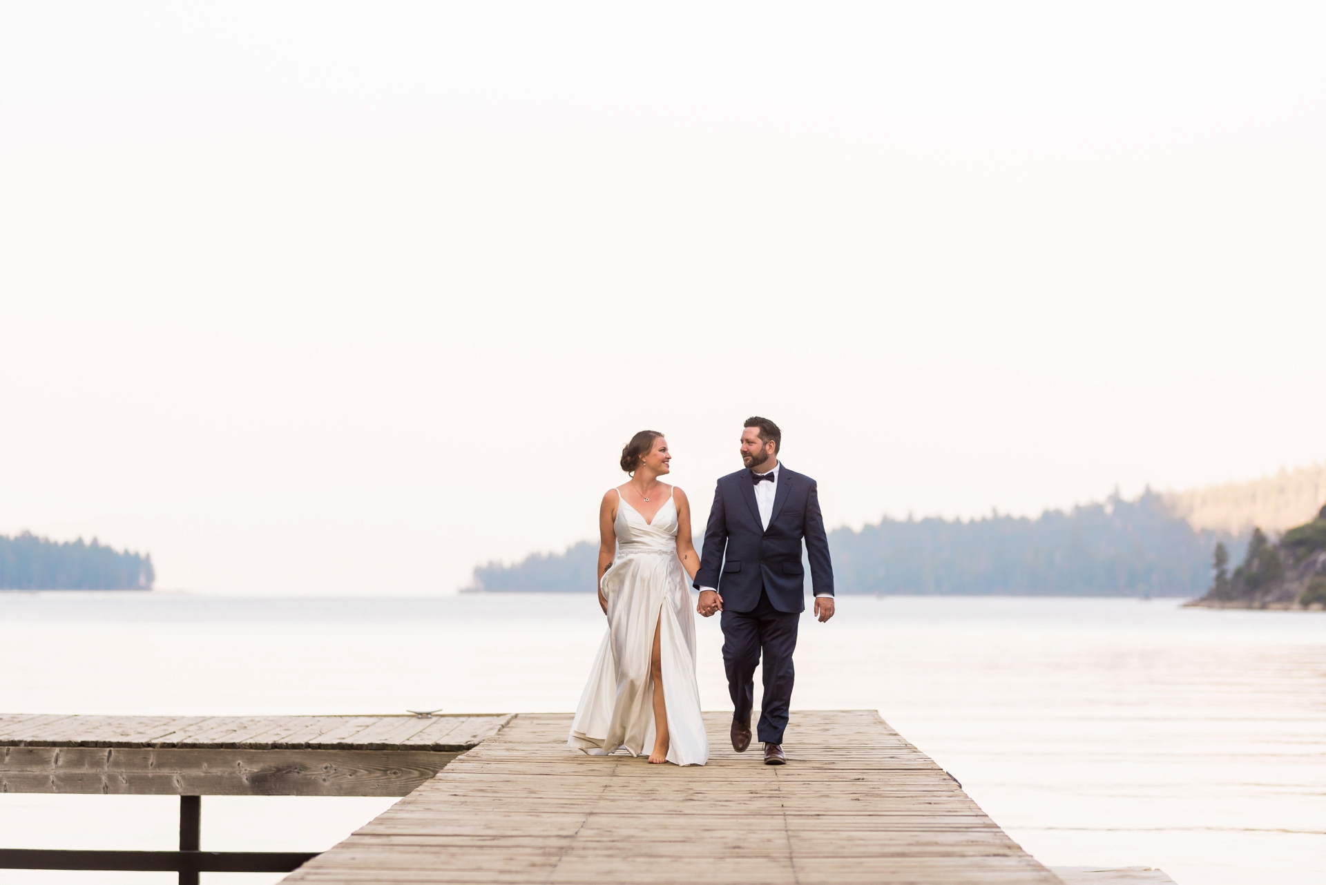 Dock Portrait after a Wedding at Emerald Bay State Park | The couple's wedding portrait on the dock