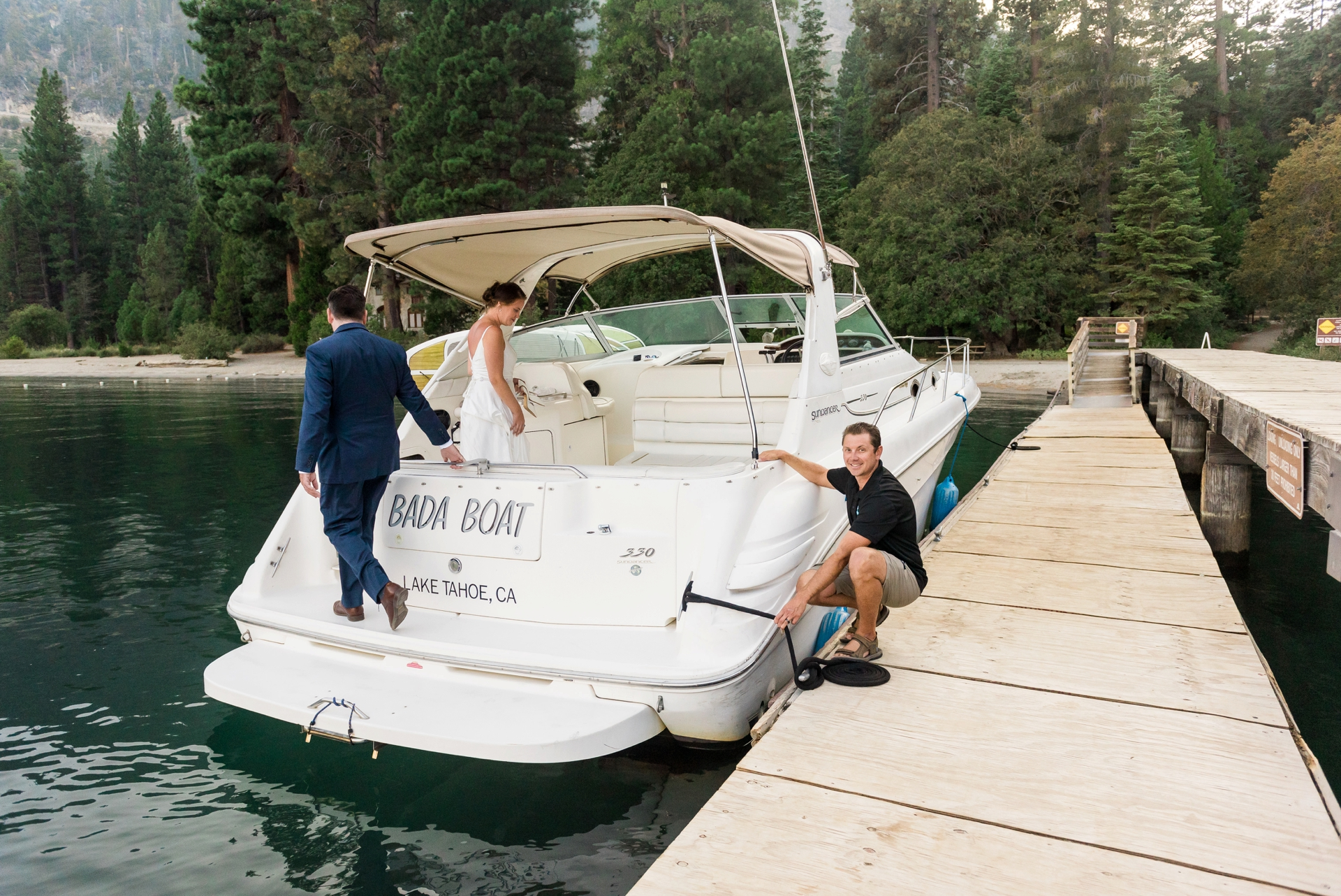 Pic from a Wedding Boat Cruise on Lake Tahoe | The bride and groom reboard the Boda Boat, their Lake Tahoe Boat Rides Charter