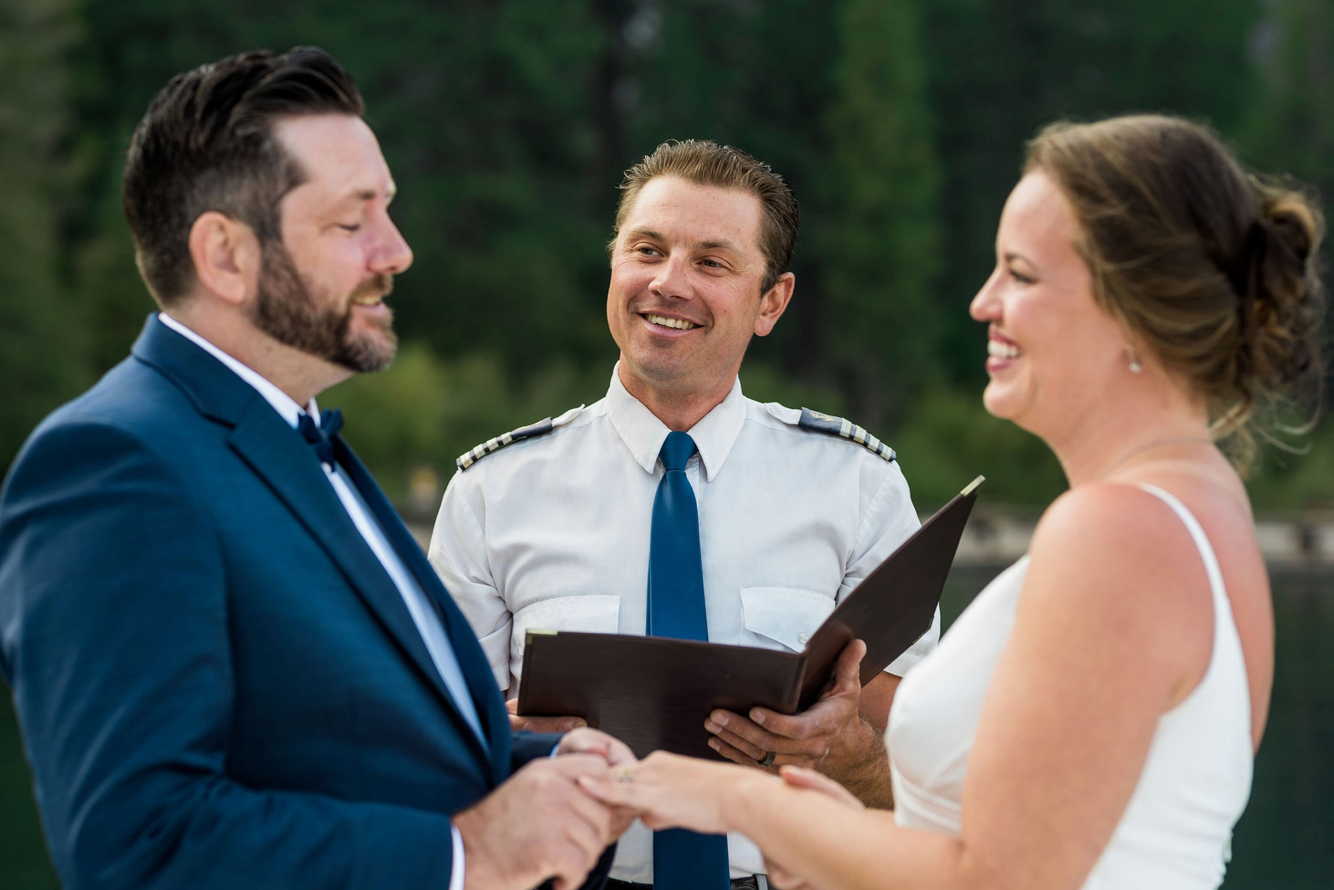Emerald Bay, Lake Tahoe, CA Wedding Ceremony Pics | Captain Steve looks on while the couple share their elopement vows