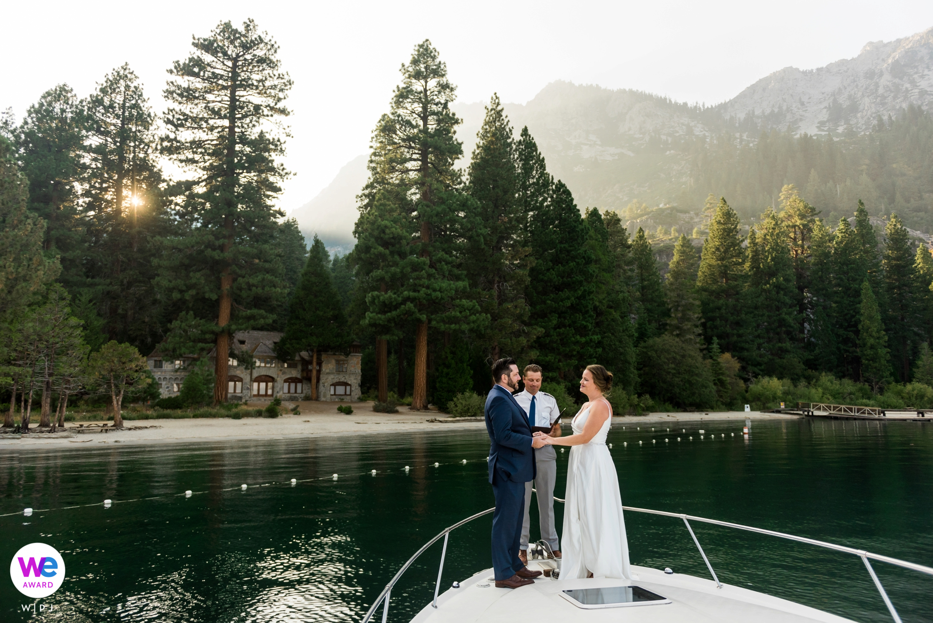 Lake Tahoe Boat Ride Wedding Images | Captain Steve officiates their wedding ceremony on the bow of his boat