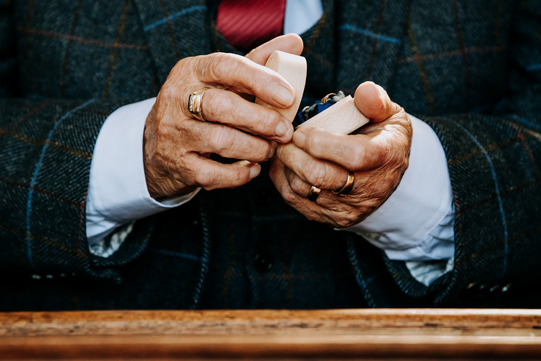 Hull Minster East Yorkshire, UK Wedding Detail Image | The groom's best man, his granddad, inspects the rings