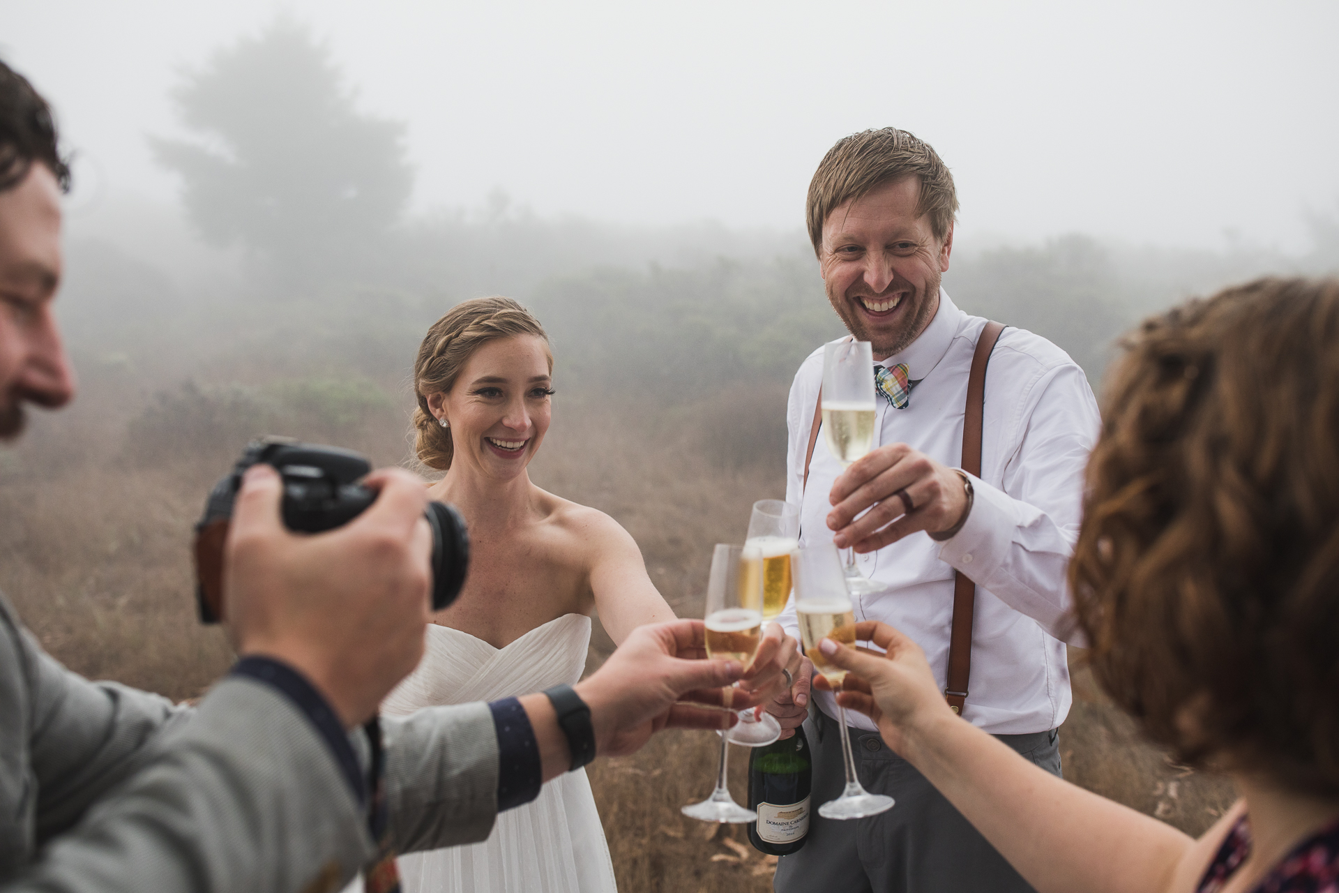 Magical Fog Redwood Forest Wedding Photography in CA | Toasting drinks from a portable table underneath a massive Live Oak Tree