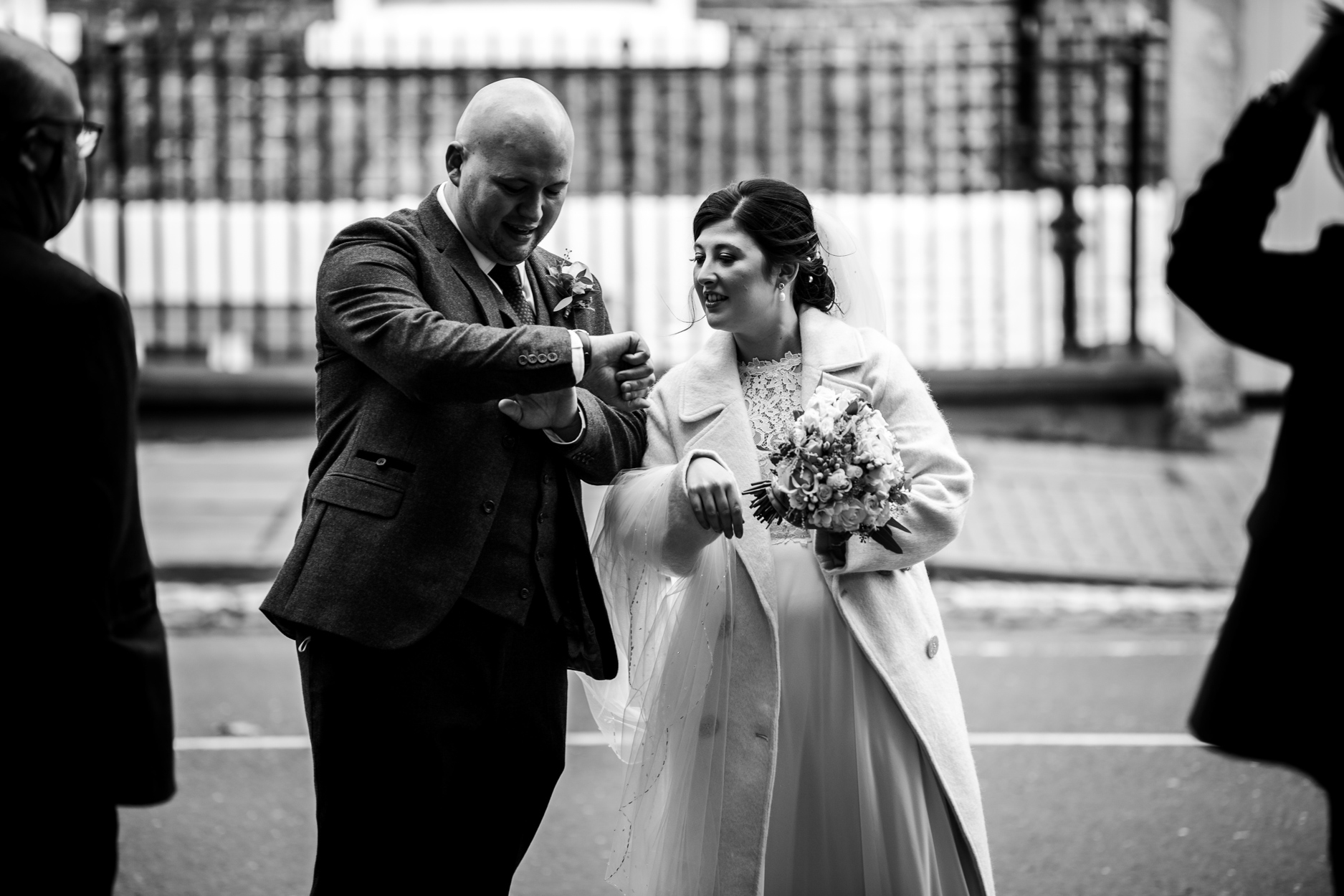 York Registry Office, UK Wedding Photographer | The bride and groom check the time