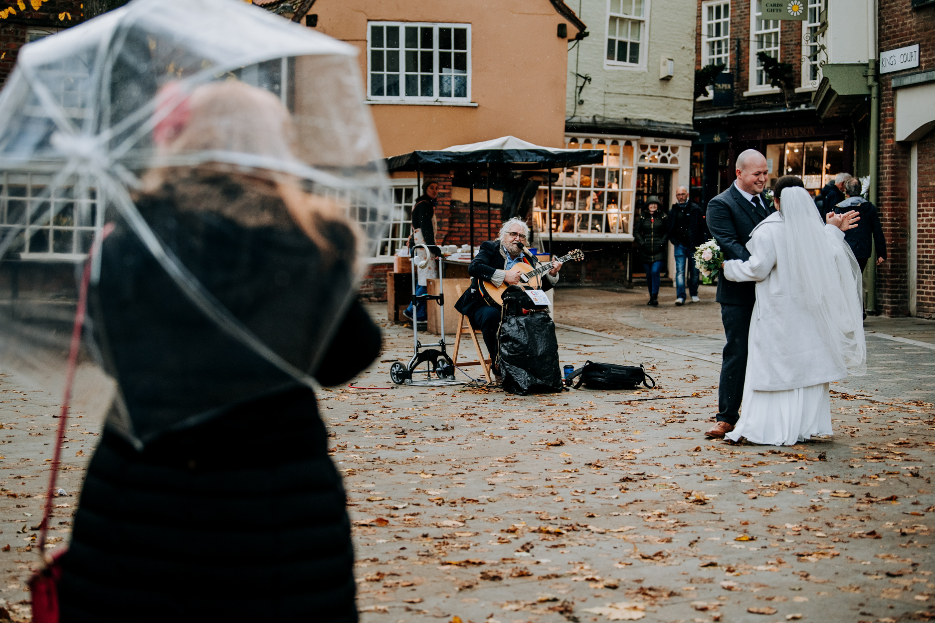 The Streets Of York - Wedding Photos | The newlyweds dance in the rain