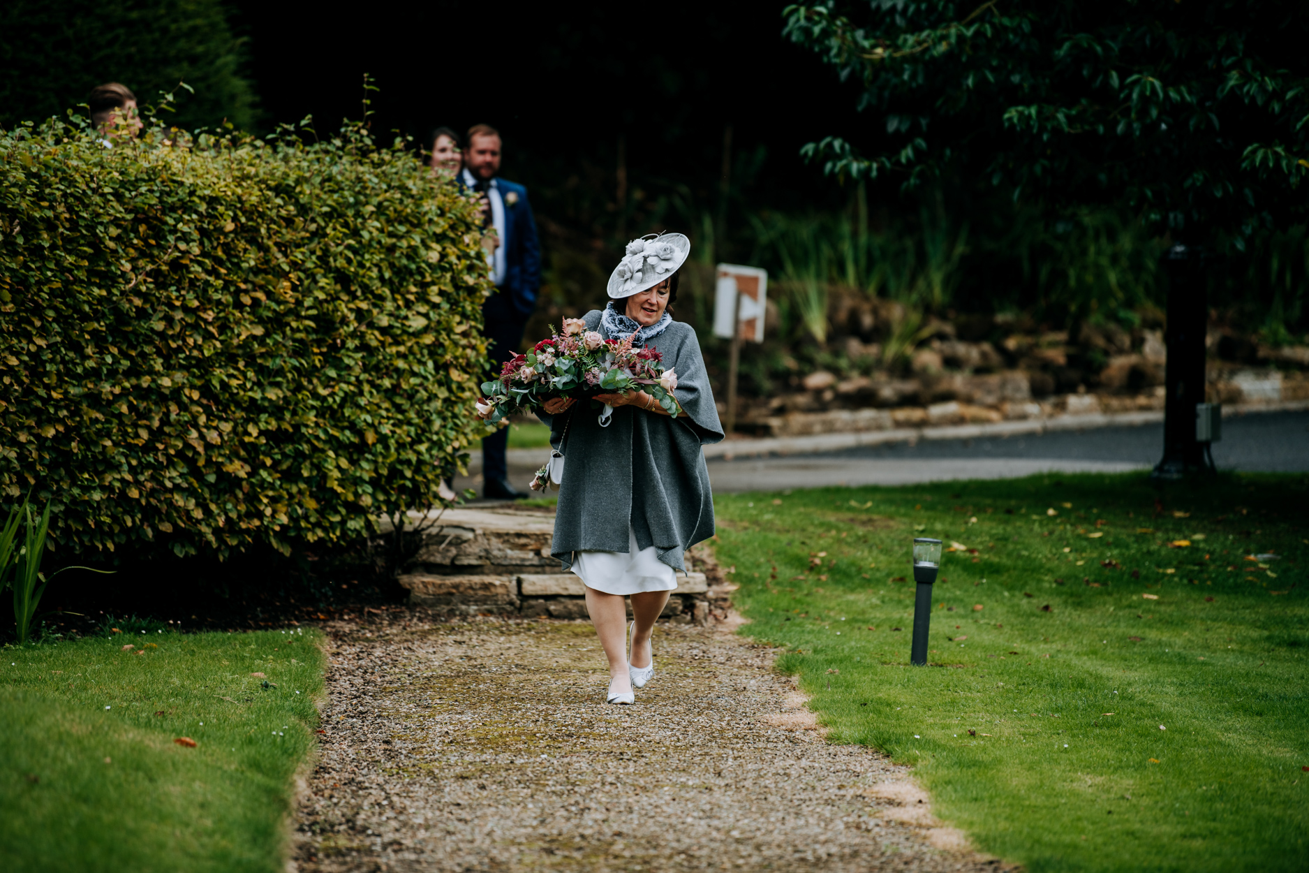 Wedding Image - Hackness Grange Hotel Scarborough | The mother of the bride arrives carrying flowers