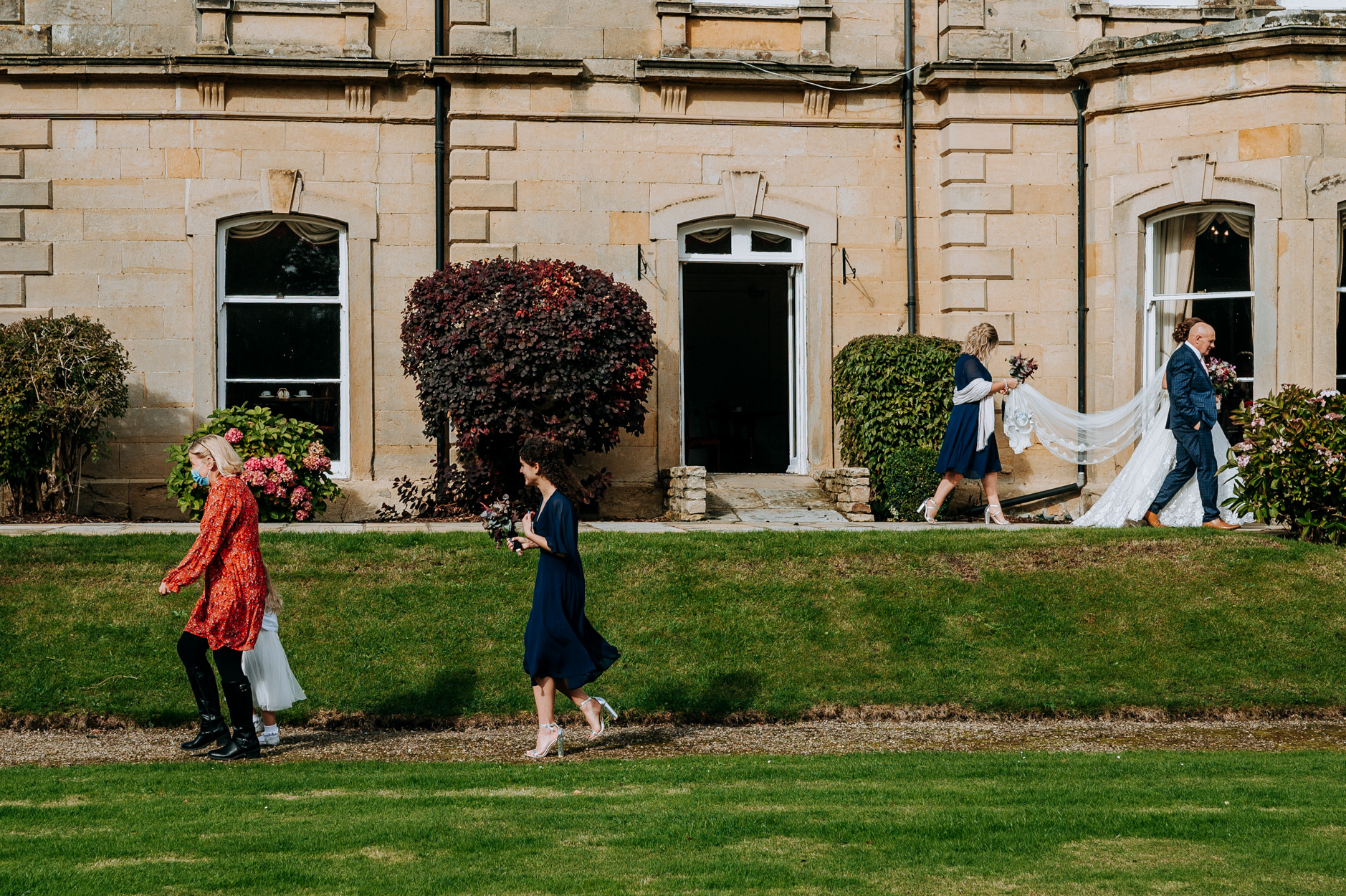 Hackness Grange Wedding Photography | The bridal party walks to the outdoor ceremony