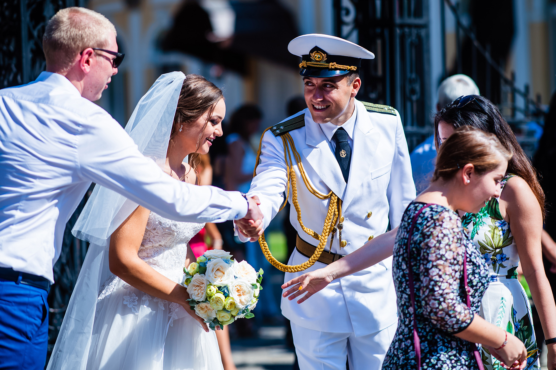 Ruse City Center Wedding Photos | On a sunshine-filled day, the wedding guests congratulate the happy couple