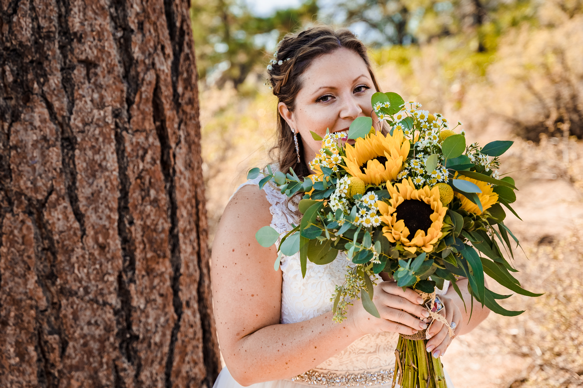 Logan Shoals Bride Pic | beaming as she holds her bouquet
