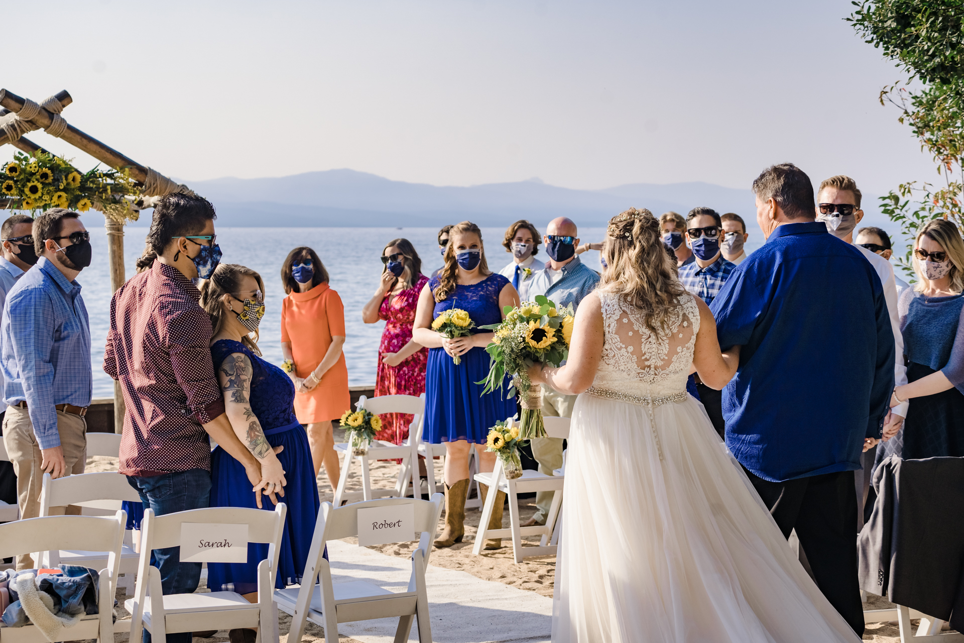 A Wedding at Lakeside Beach - Wedding venue images | The bride and her father walk down the aisle of the outdoor ceremony