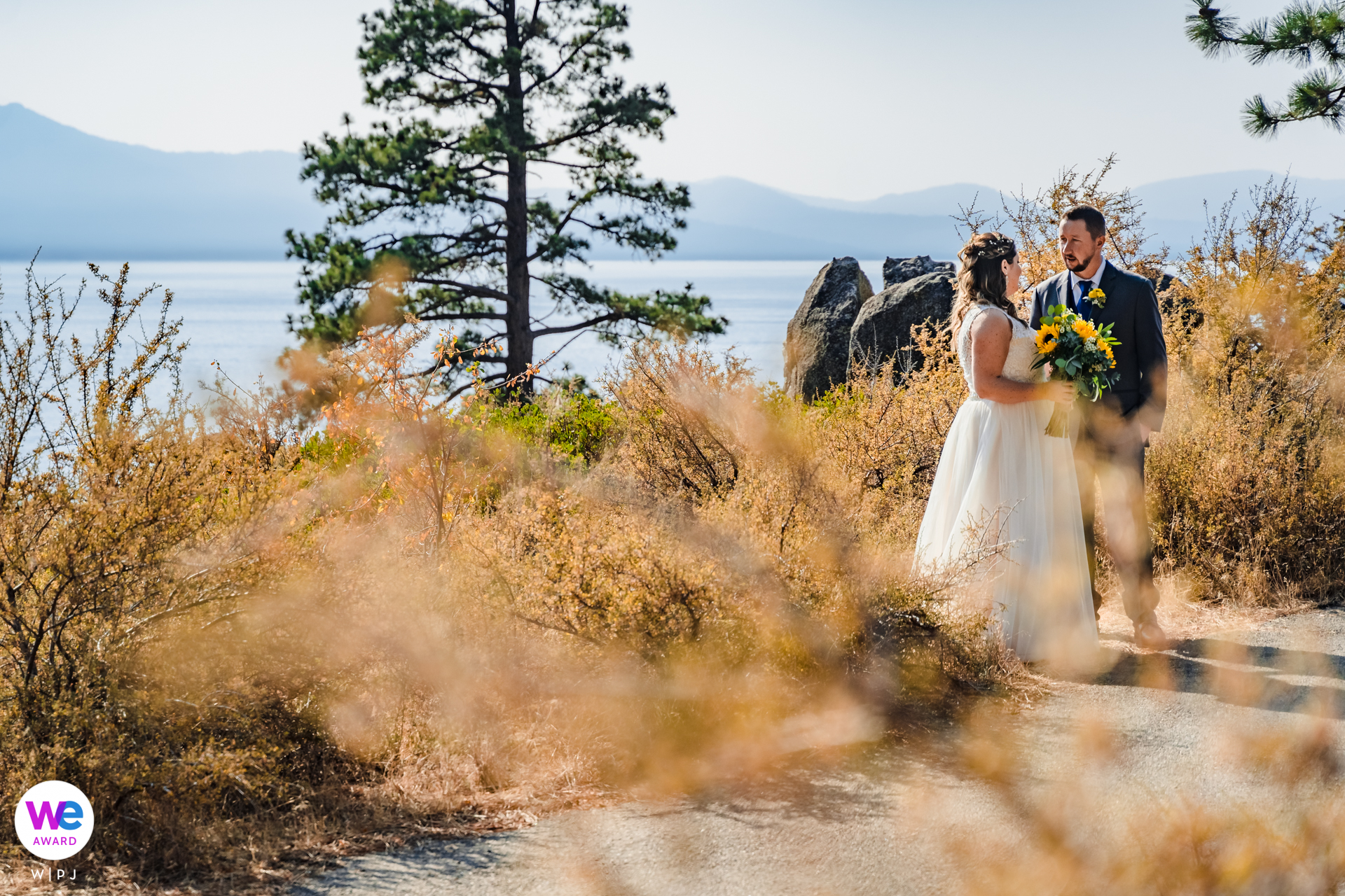 Zephyr Cove, NV Wedding Couple Image | The bride and groom share a few minutes together before the outdoor ceremony