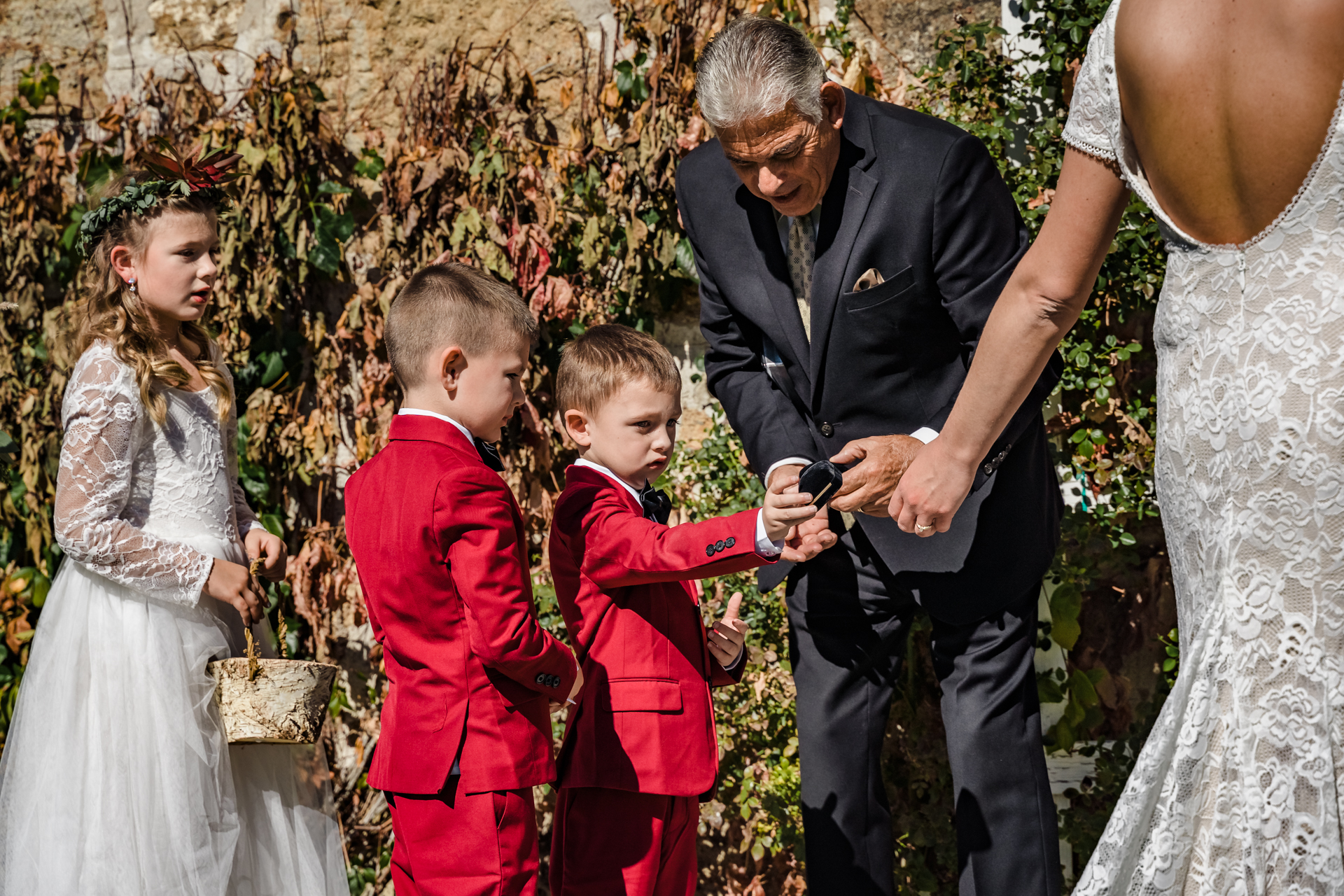 Wedding Photos - Dangberg Ranch Historic Park | A young nephew hands over the ring box