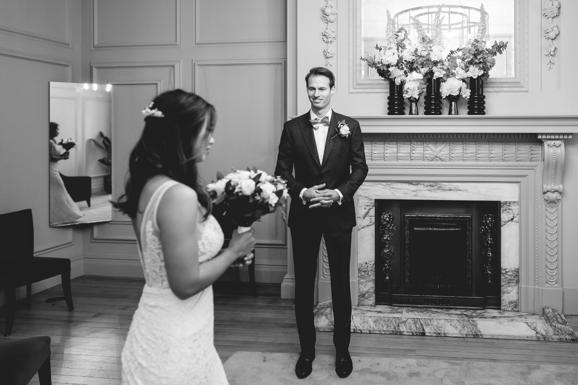 Old Marylebone Town Hall Wedding Photographer | The groom is very happy as his bride walks in