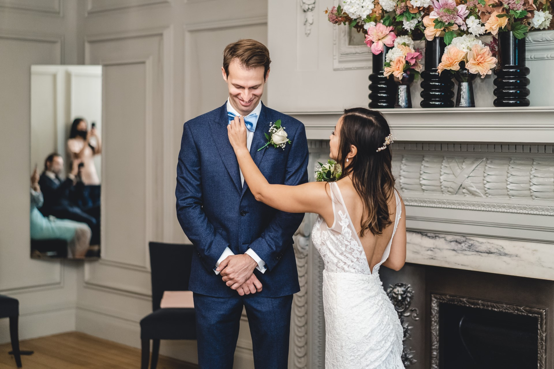 Old Marylebone Town Hall Weddings - London Photographer | The bride makes one last adjustment