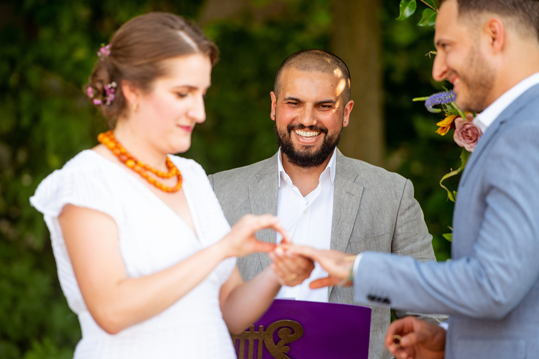 Backyard Wedding Ceremony Photos | The officiant is a friend of the couple