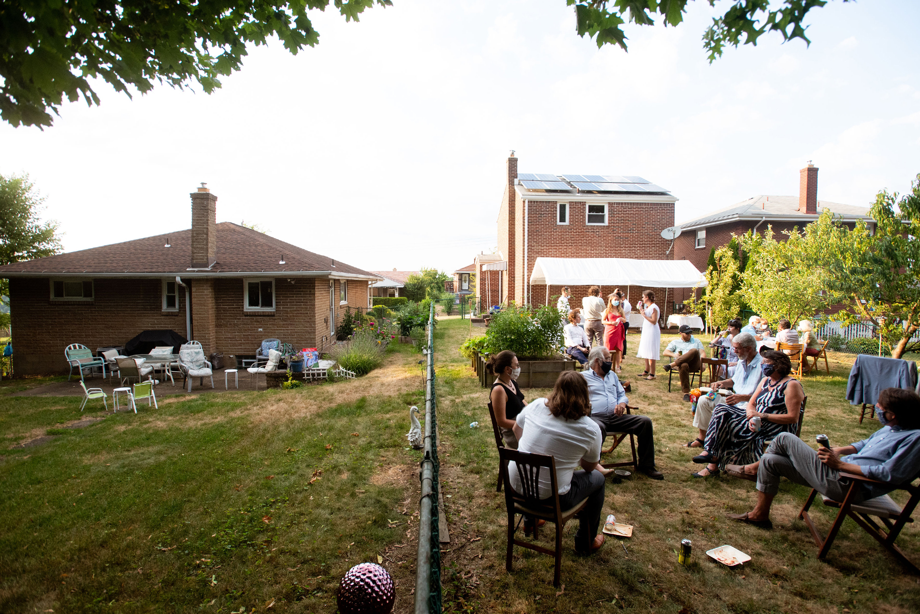 Backyard Weddings - PA Photographer | empty chairs to the house on the left verses how packed it is to the right