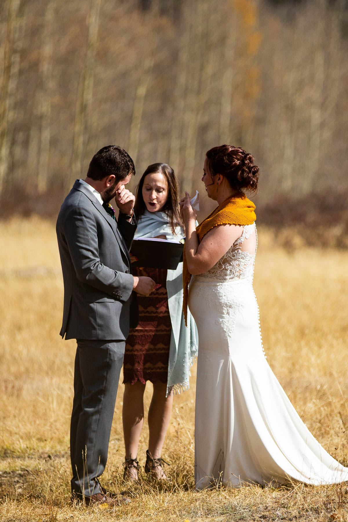 Kenosha Pass Colorado Weddings - Outdoor Ceremony Photos | The grooms emotions come to the surface as he finally gets to marry his bride