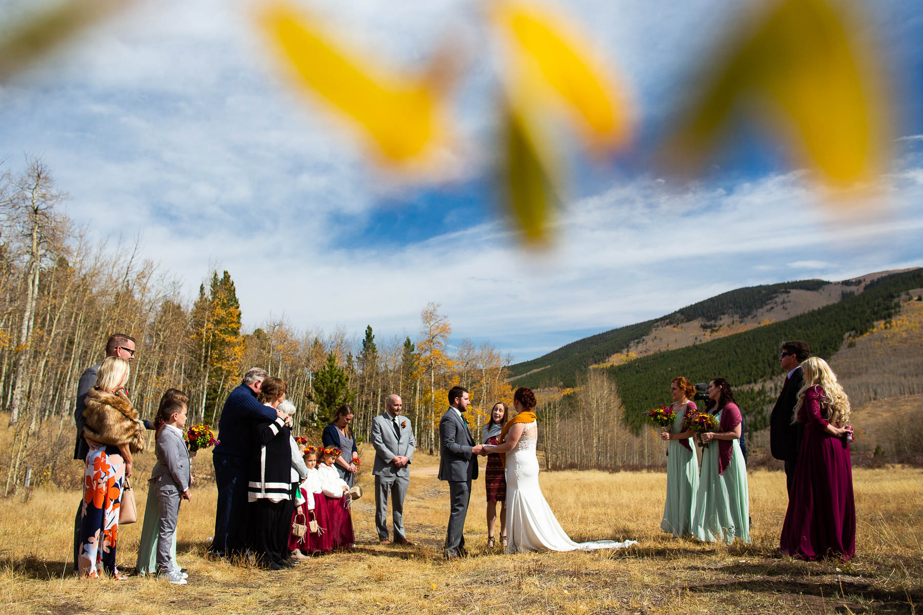 Colorado Wedding, Elopement Photography | Gold aspen leaves frame the meadow where they gathered