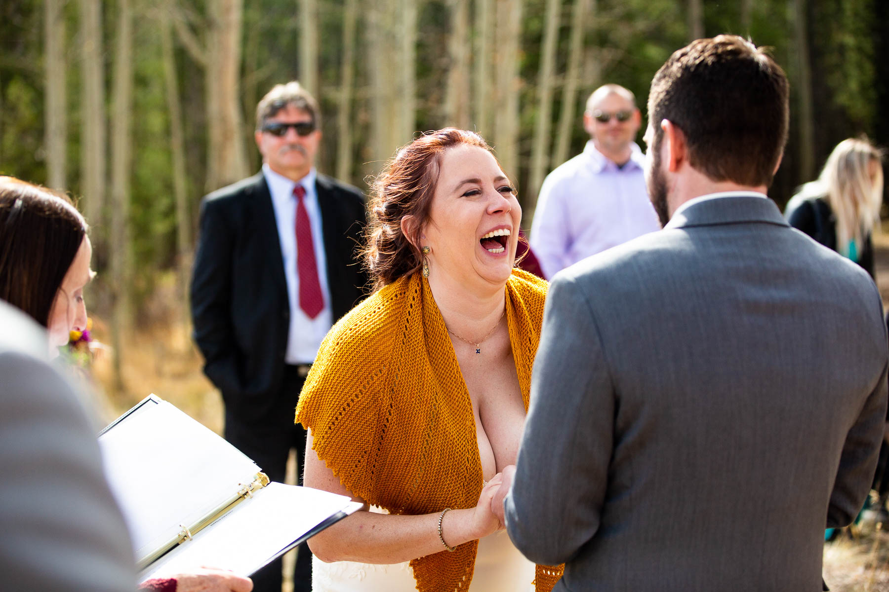 CO Images from a Kenosha Pass Wedding | The groom recites his vows to the bride at their outdoor elopement ceremony