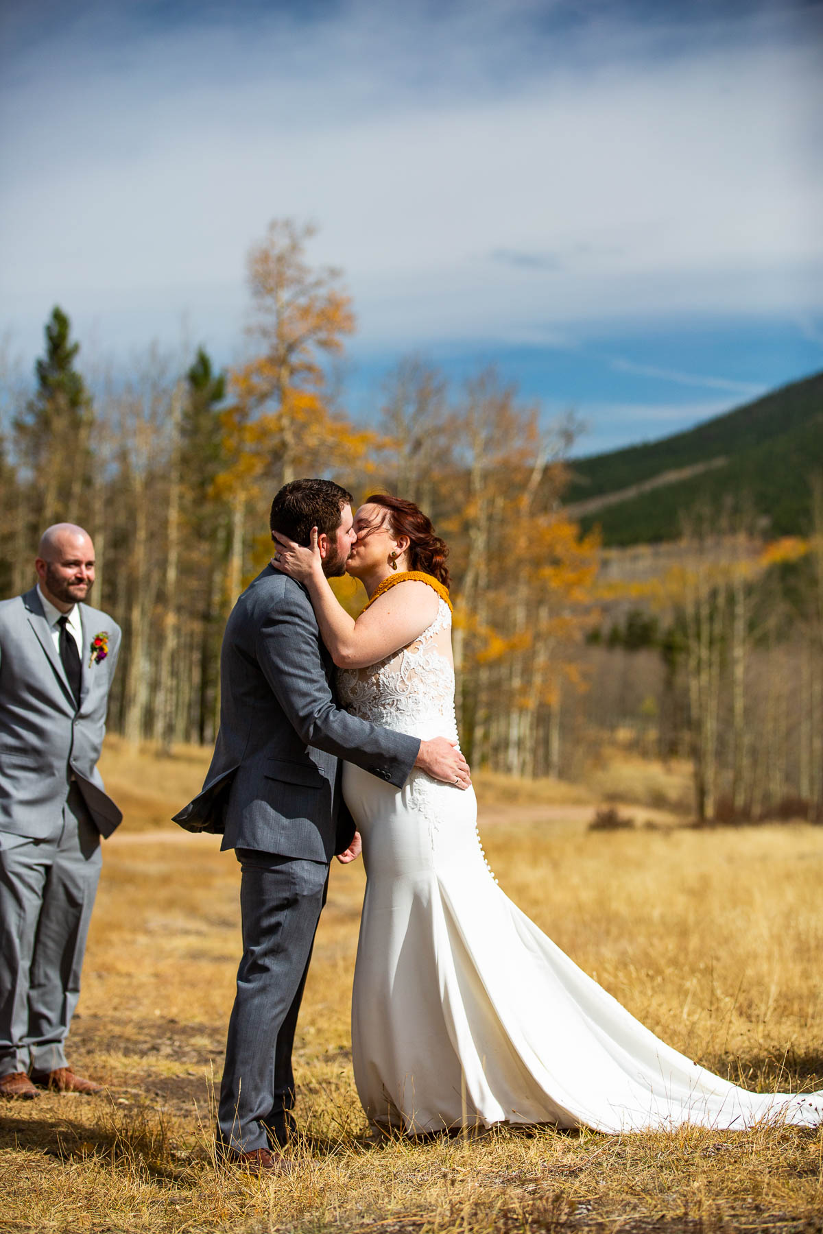 CO Photographer - Kenosha Pass Wedding Ceremony | The couple shares their first kiss as husband and wife