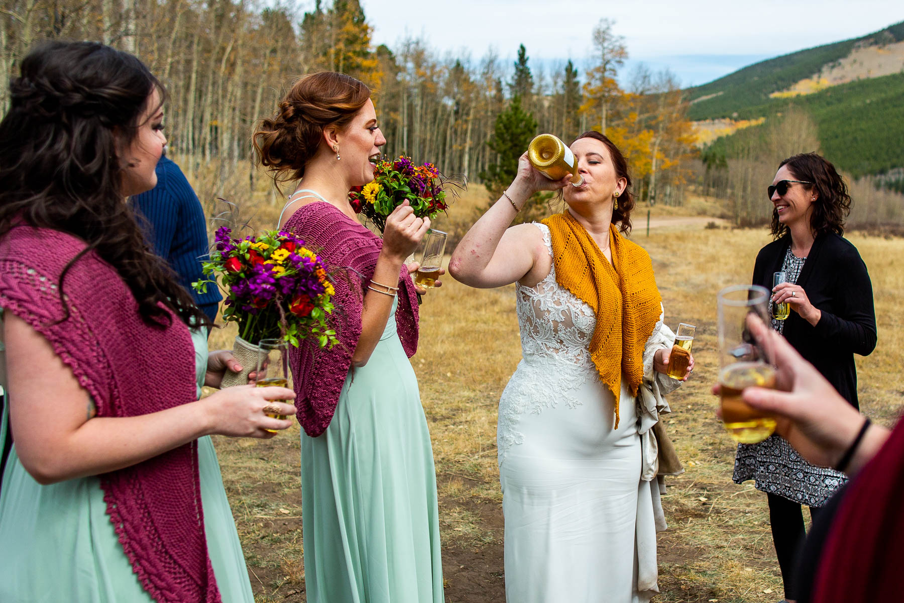 Kenosha Pass Adventure Wedding Pics | The bride ditches her champagne glass