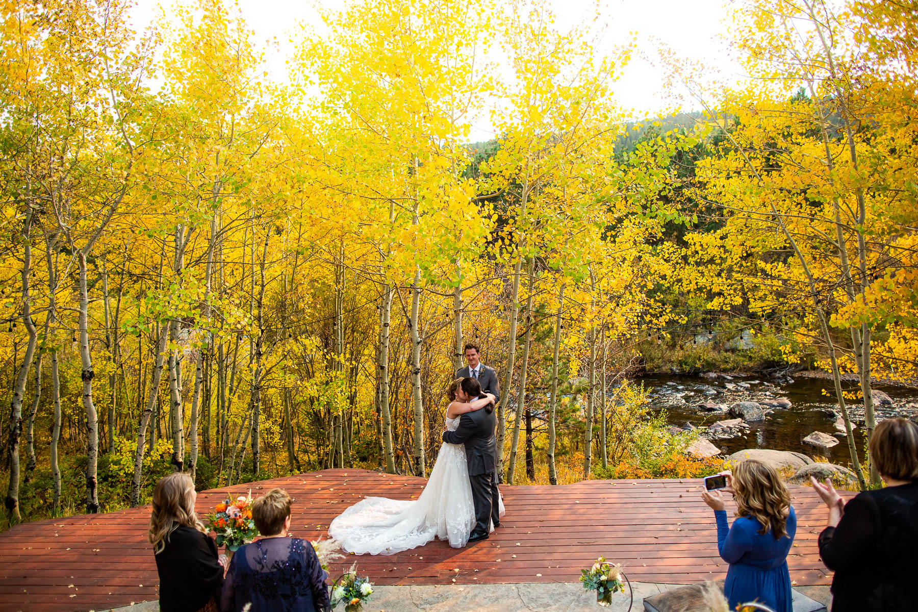Wild Basin Lodge Outdoor Ceremony Site Pics | They wrapped each other up in a big embrace for their first kiss