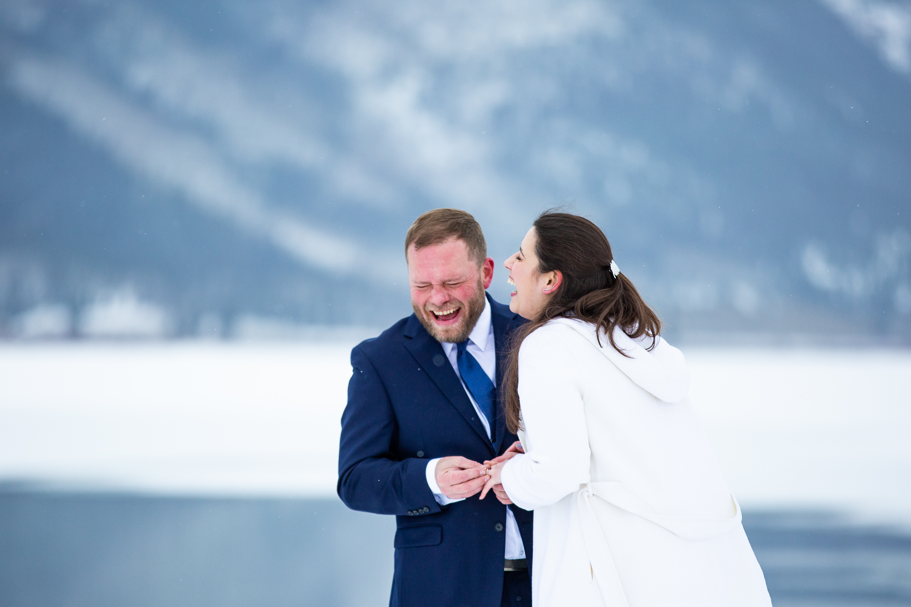Twin Lakes Colorado Wedding Photographer | The bride and groom crack up laughing as they exchange rings