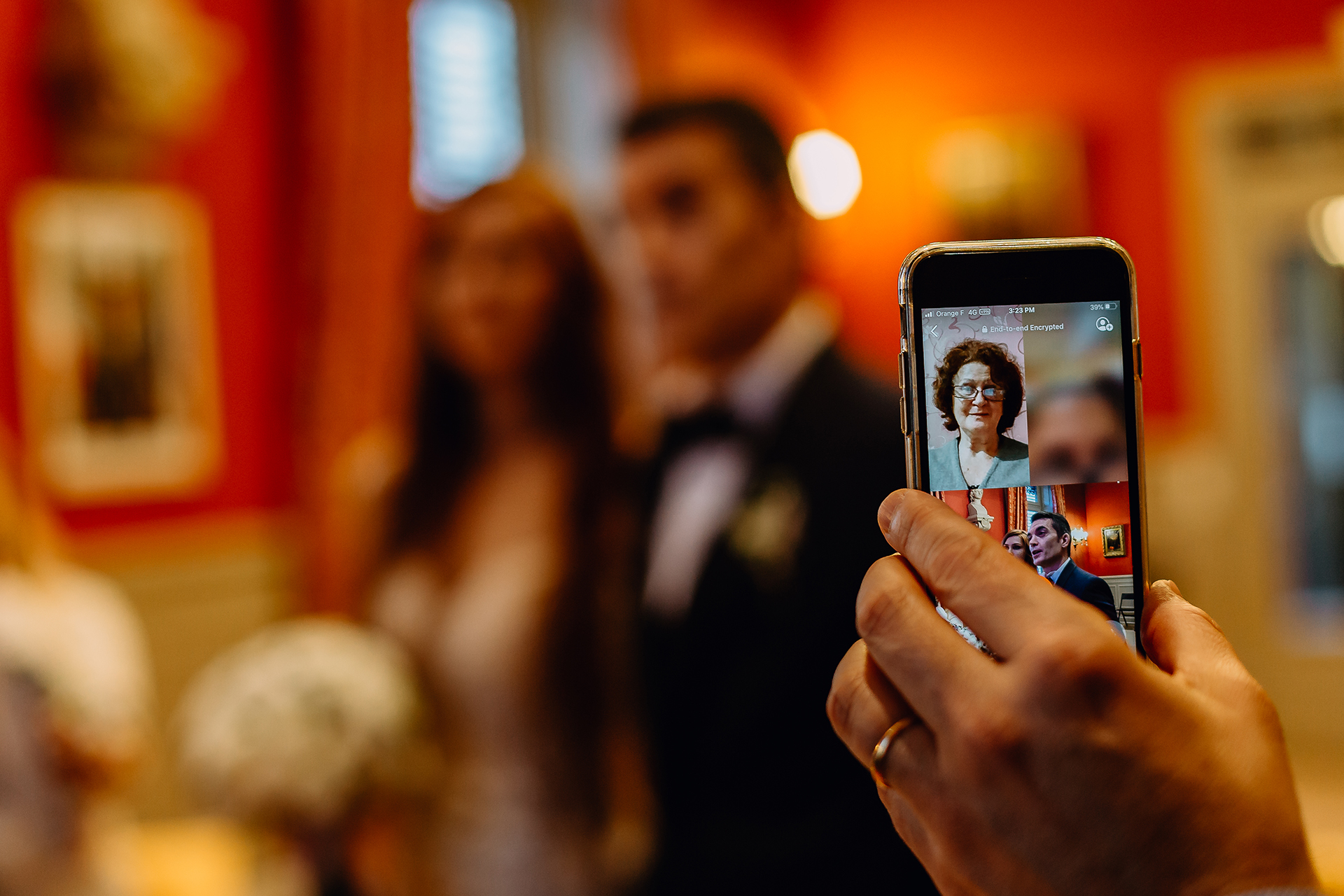 Rhône Town Hall Civil Wedding Ceremony Image | The bride and groom's families follow the ceremony by a video call