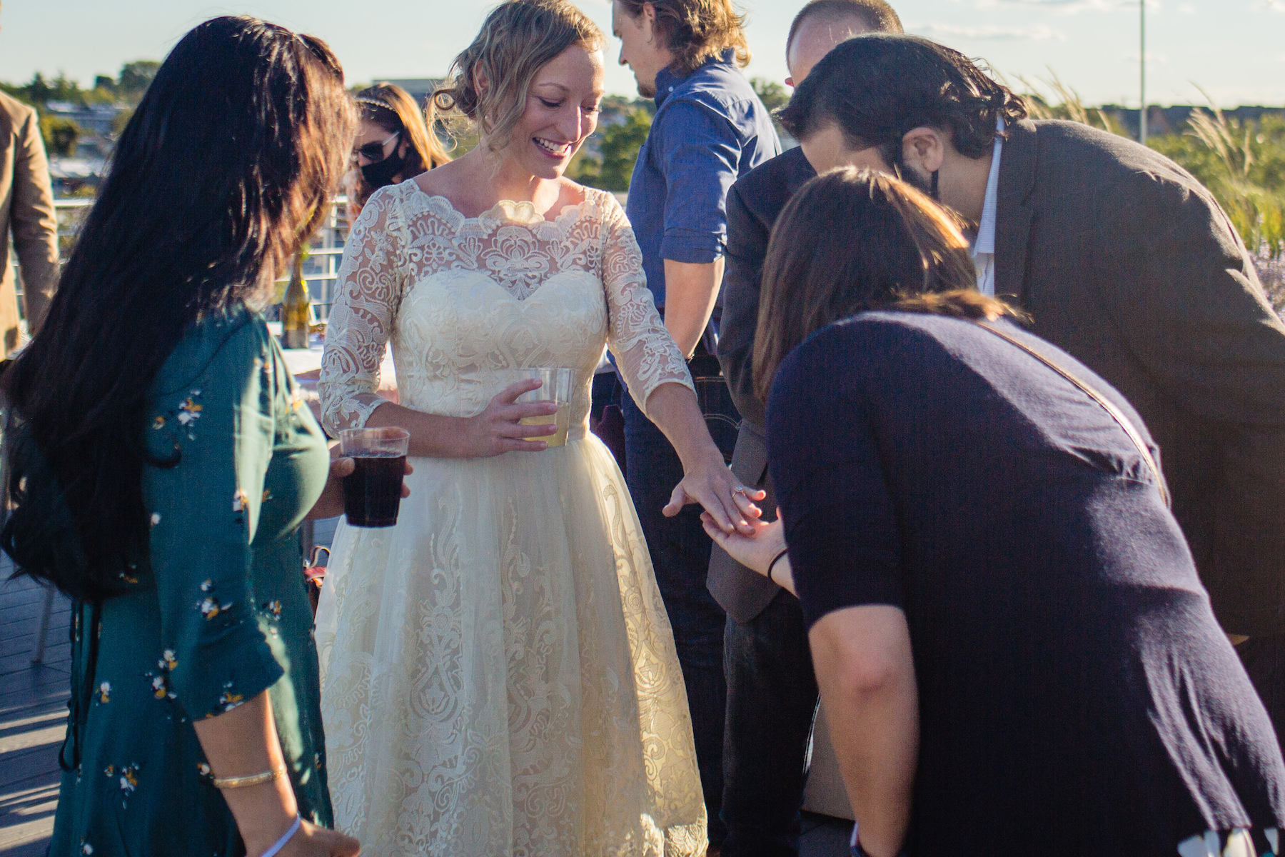 Photographer of Capitol Hill, Washington, DC Weddings | Radiating with joy and beauty, the bride shows off her wedding ring