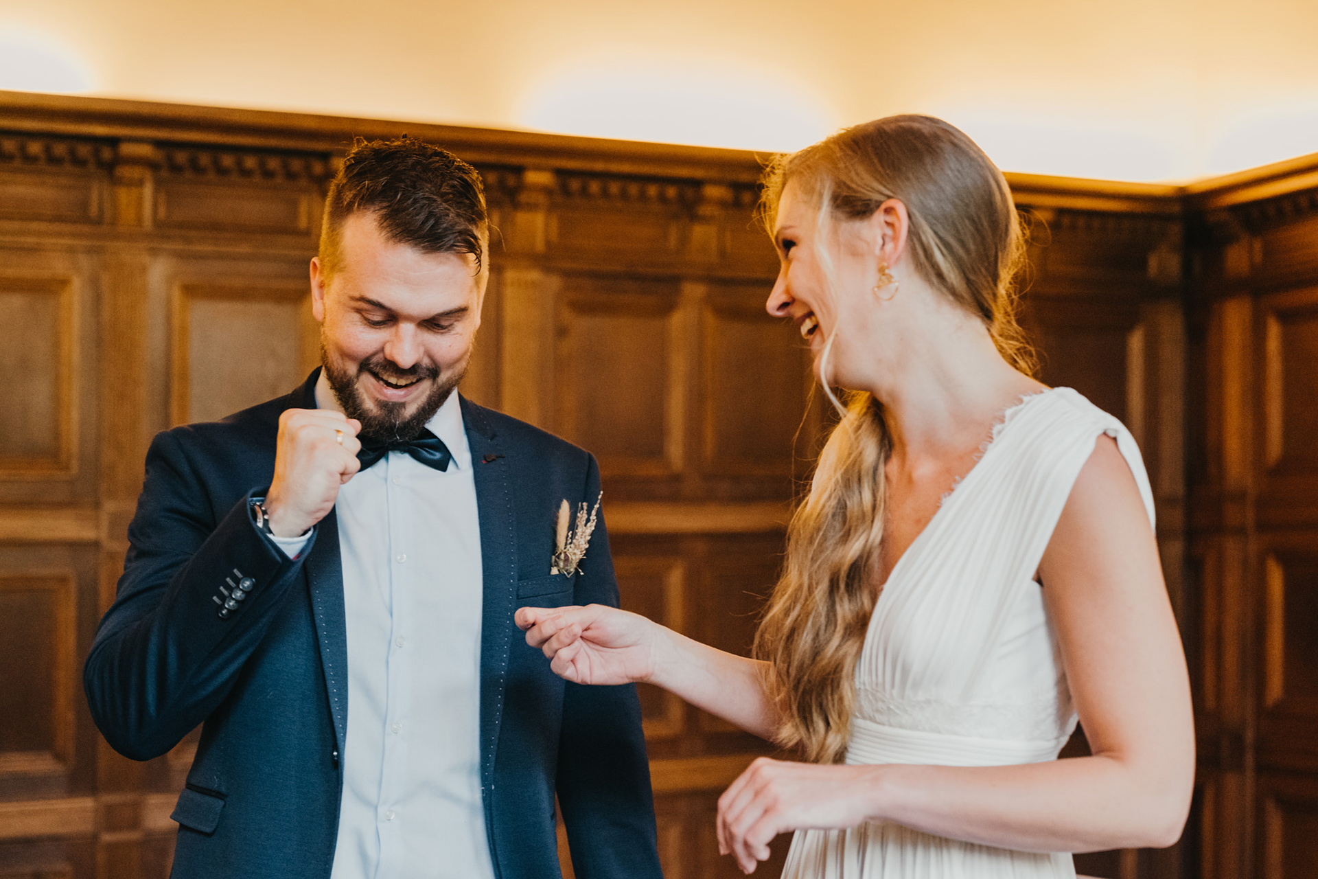 Düsseldorf Civil Registry Marriage North Rhine-Westphalia Image | The groom pumps his fist with excitement before the civil ceremony