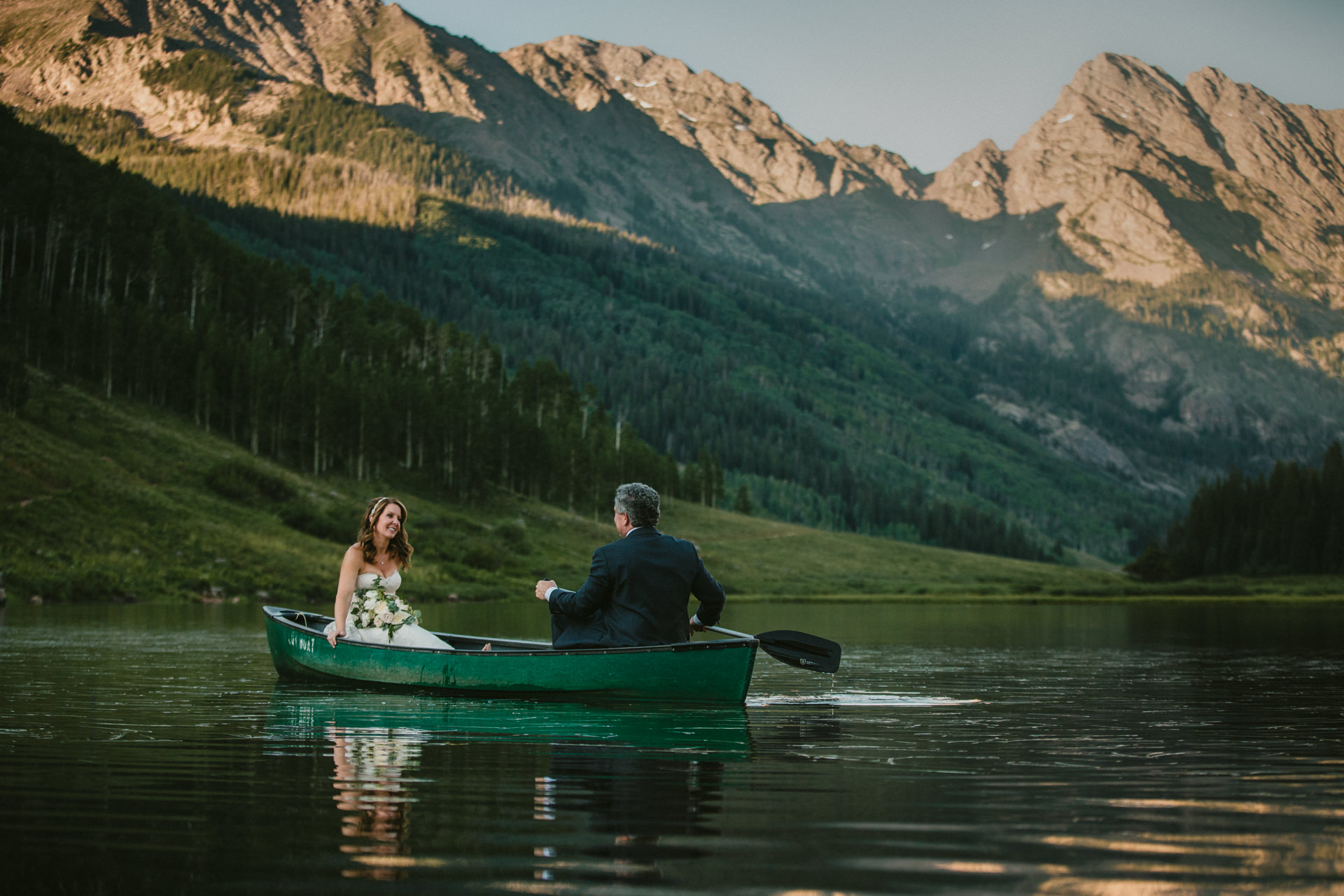 Piney River Ranch - Vail, CO Wedding Photography | a short canoe ride after dinner during sunset