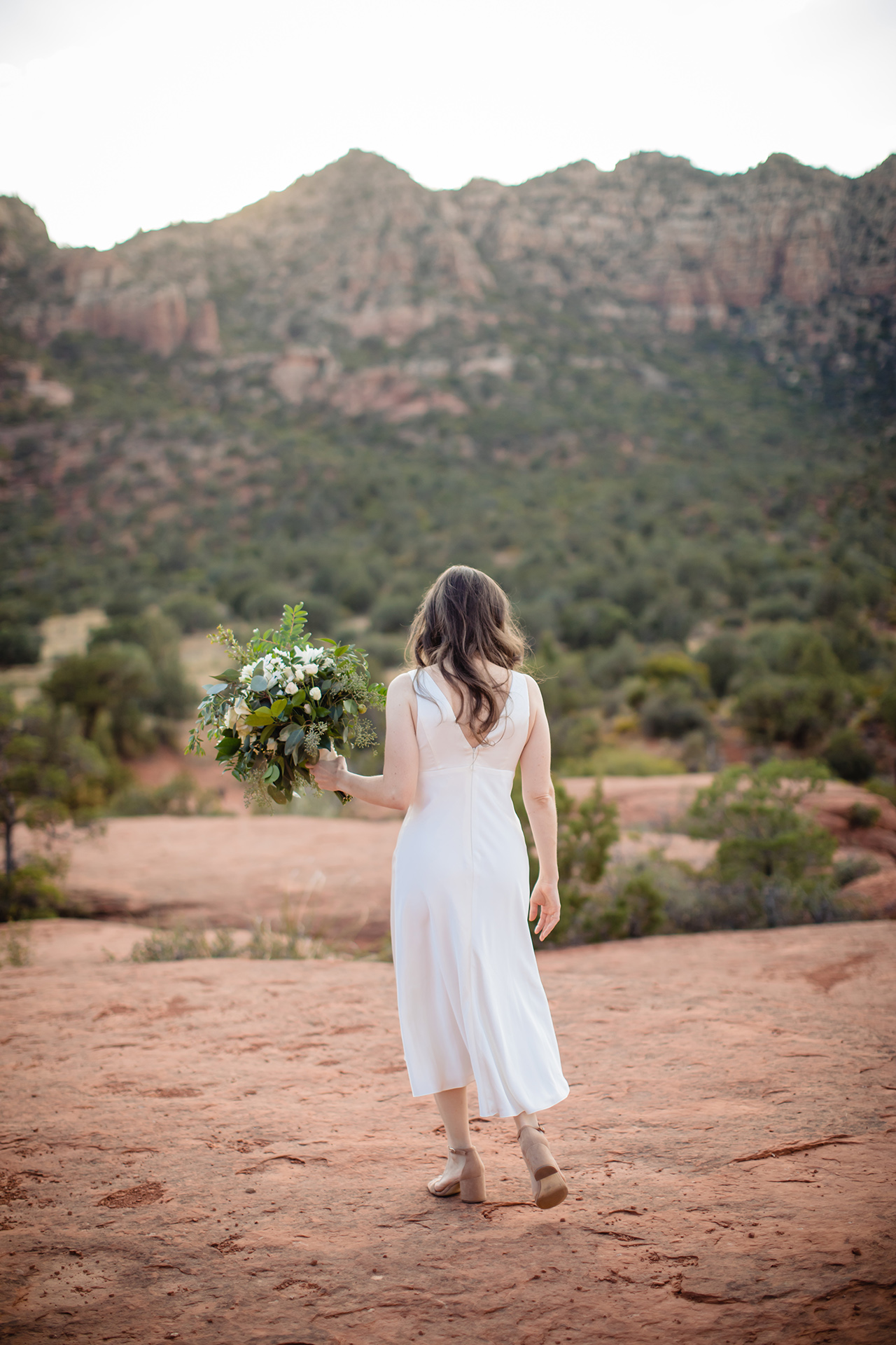 Wedding Photography for Sedona, AZ | the formidable red rocks define the desert landscape around her