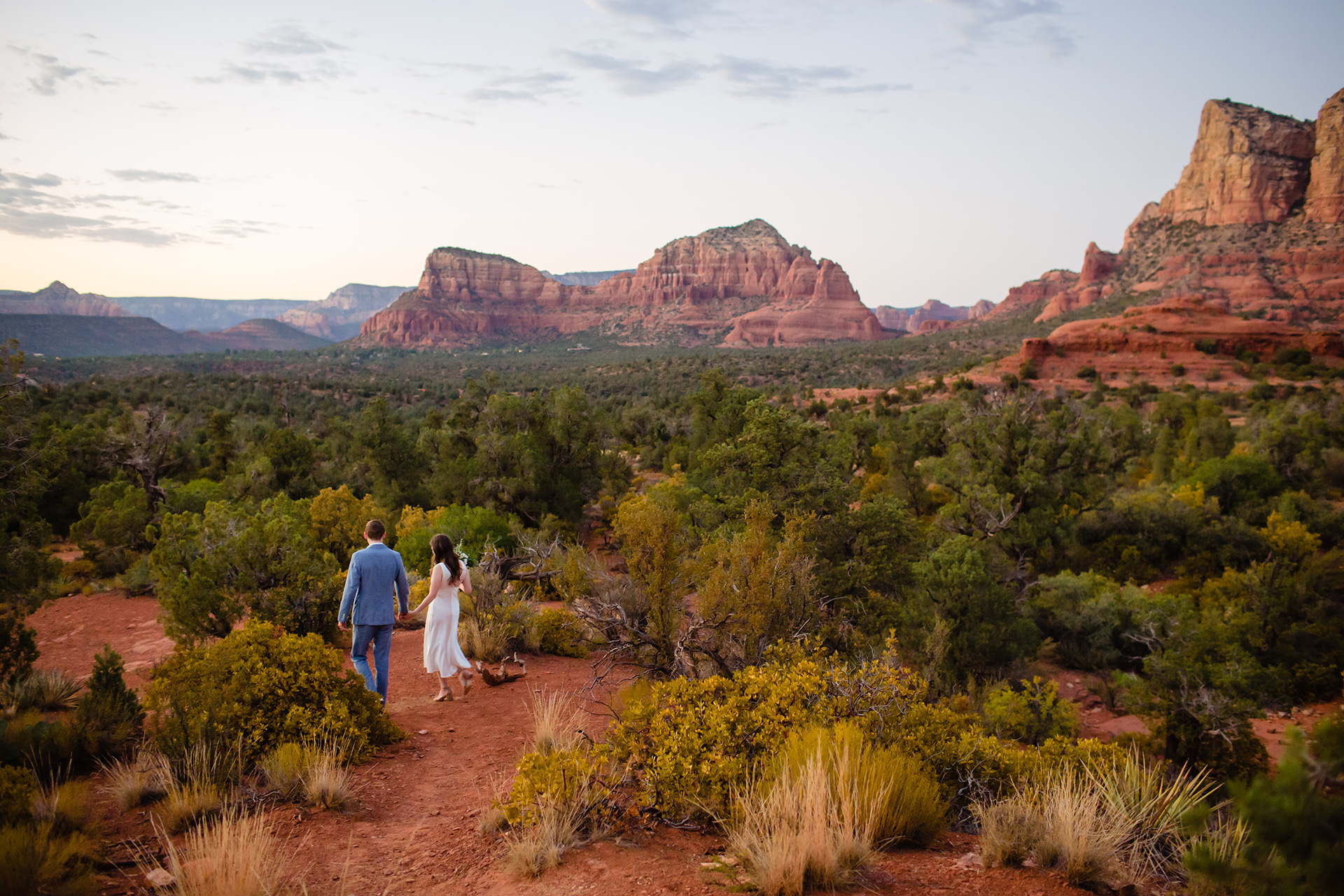 Sedona AZ Wedding Photographer | The bride and groom share a quiet moment together as they walk back down the trail