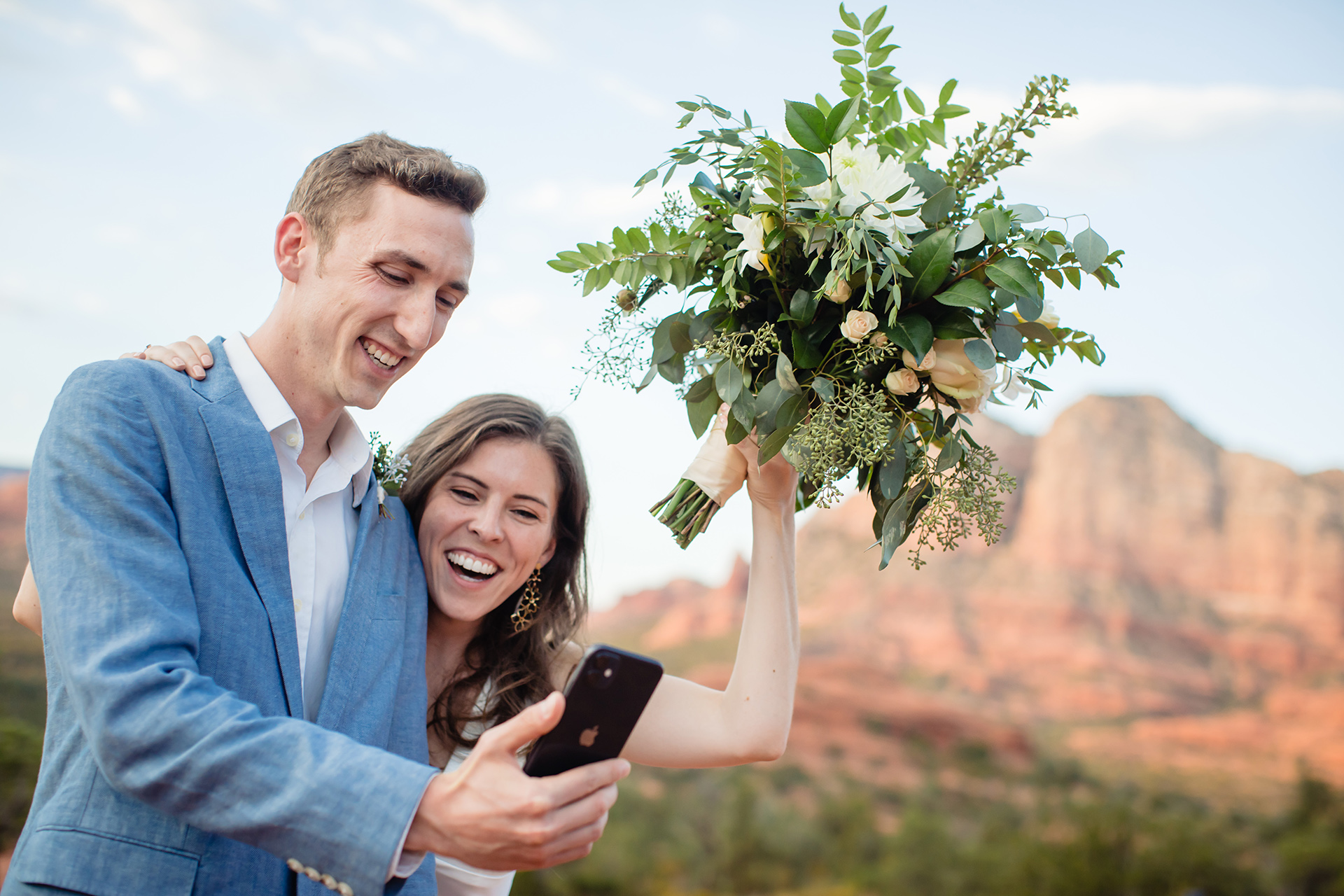 Sedona Wedding Photography & Elopements | The couple video chat with family members and friends immediately after the ceremony