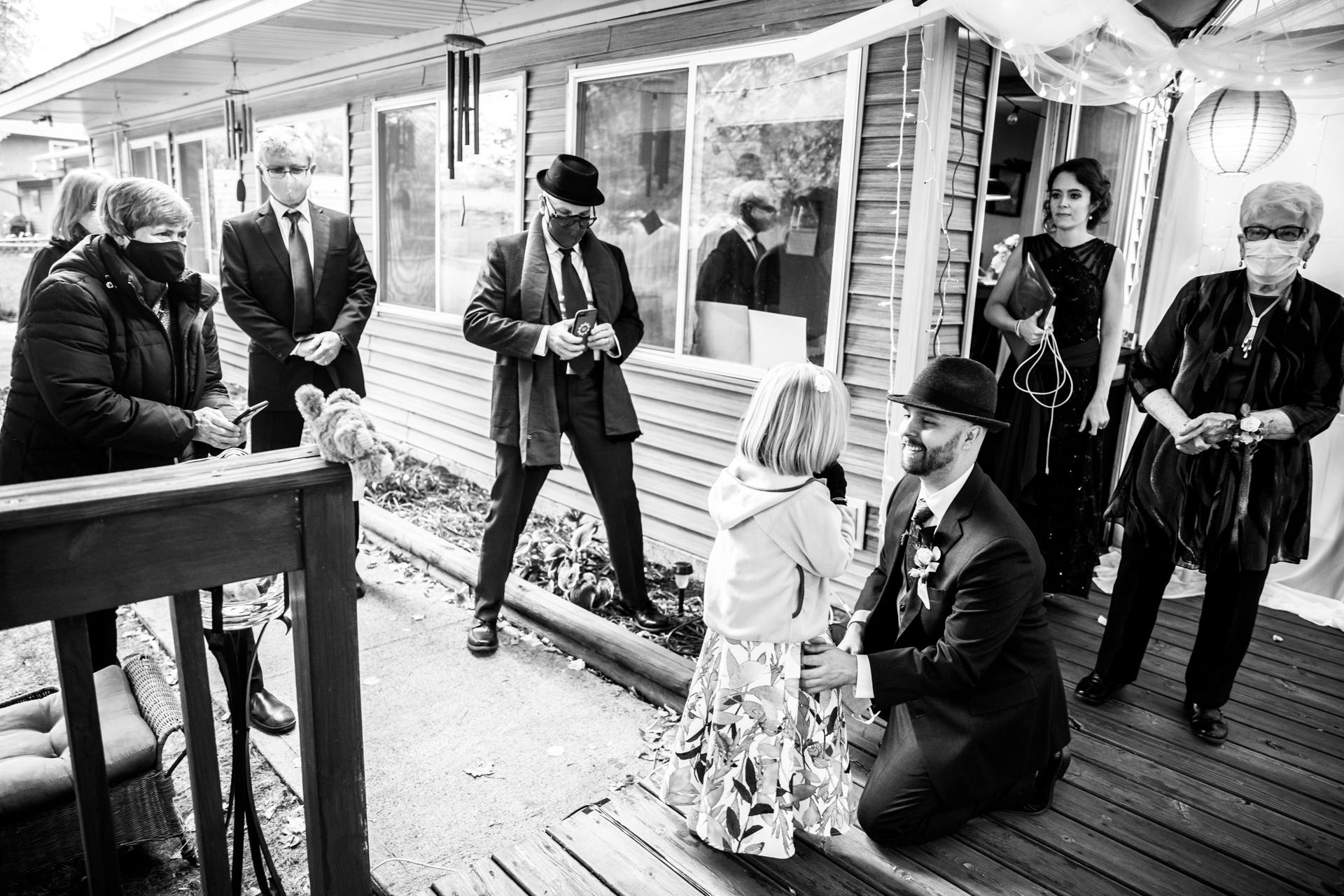 Minneapolis Wedding Photographer   Family and friends gather together before the backyard ceremony