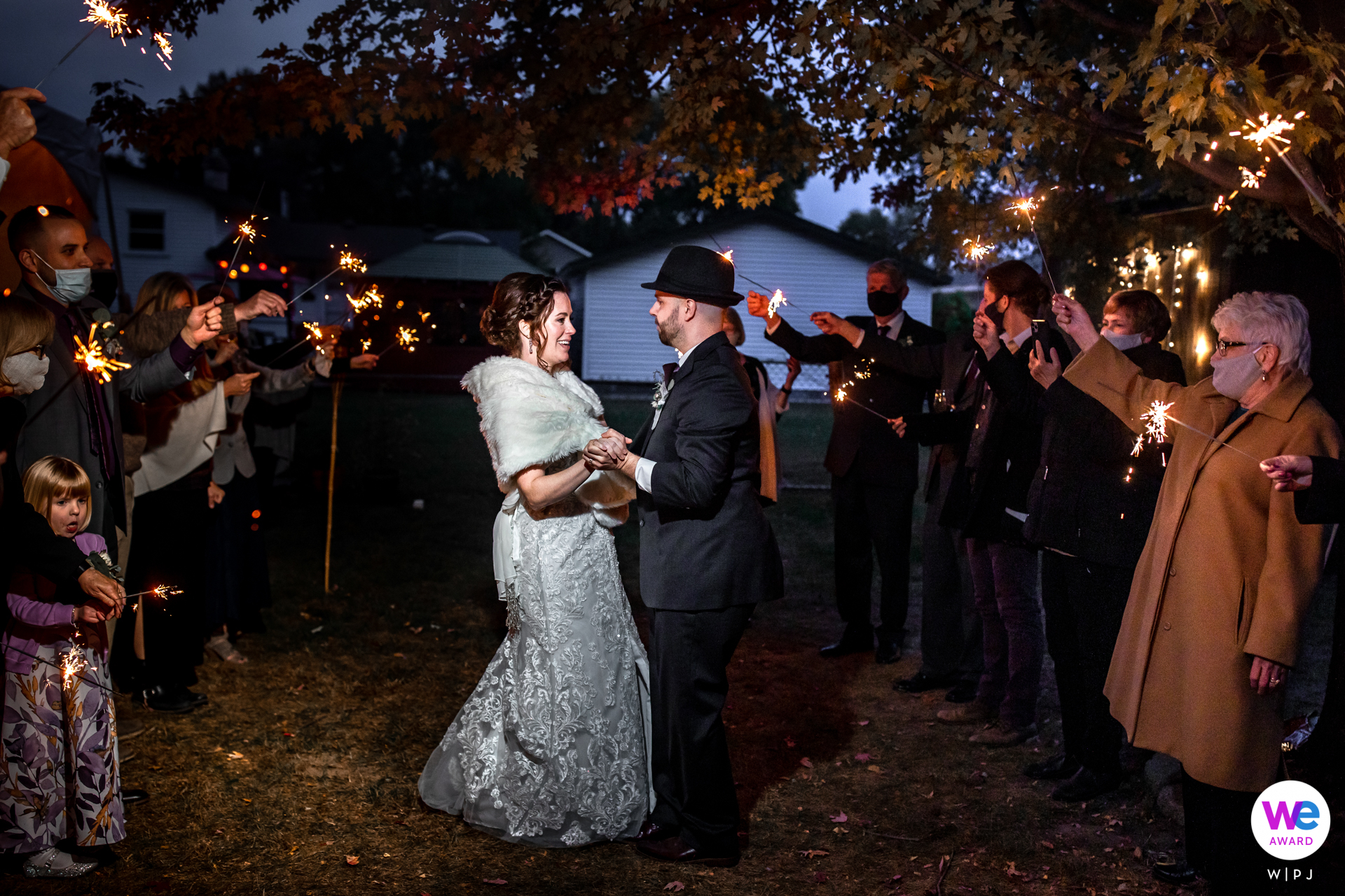 Minnesota Backyard Wedding Image   The couple dances for their guests by sparkler light