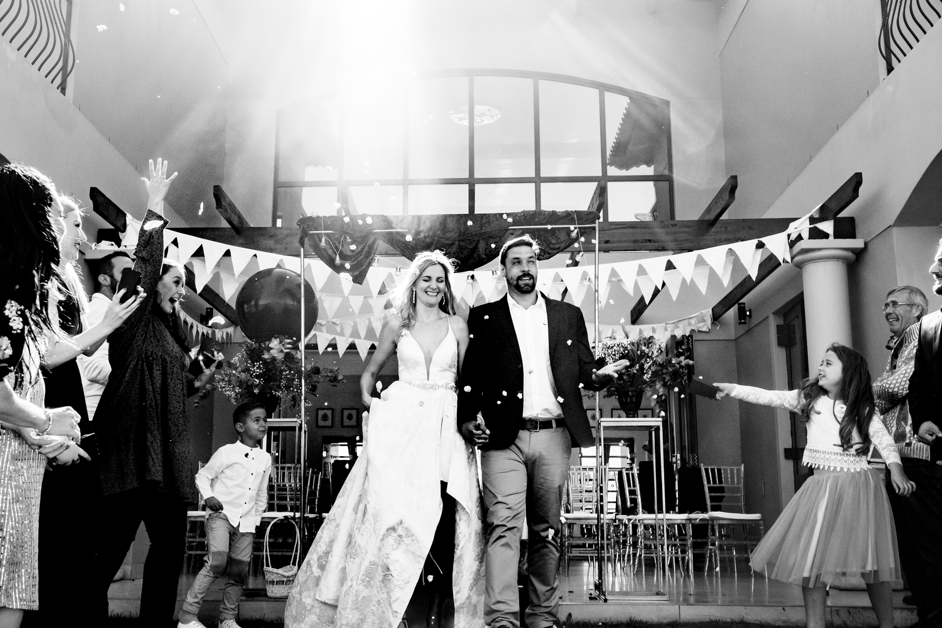 Cape Winelands Wedding Photographers | The couple are bestowed with popcorn confetti