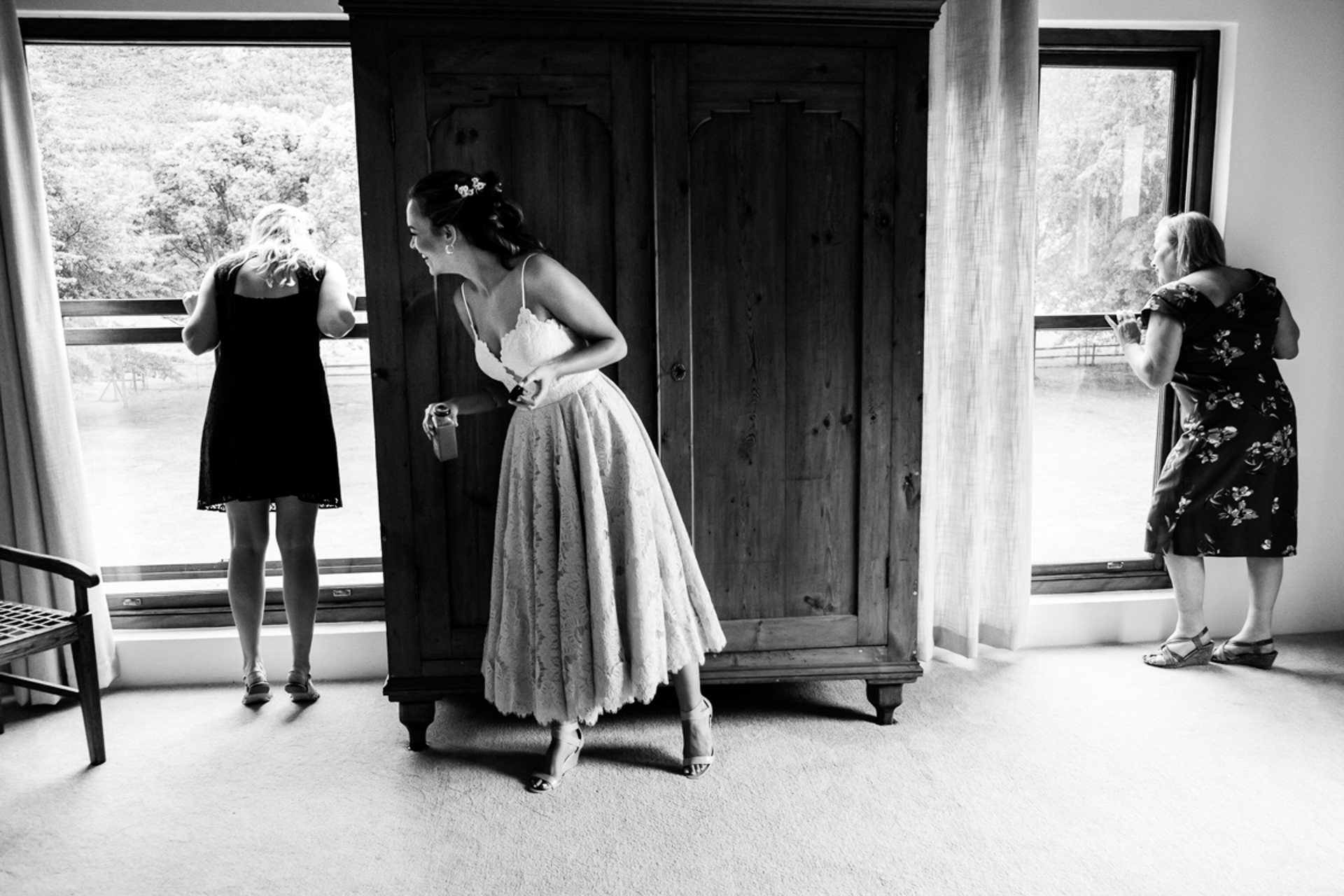 Cape Town Wedding Photographers of SA | The bride hides behind a cupboard