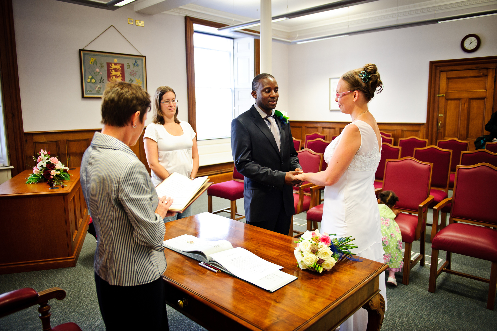 Marriage Photo from Guernsey Royal Court | The couple pledges their vows to one another