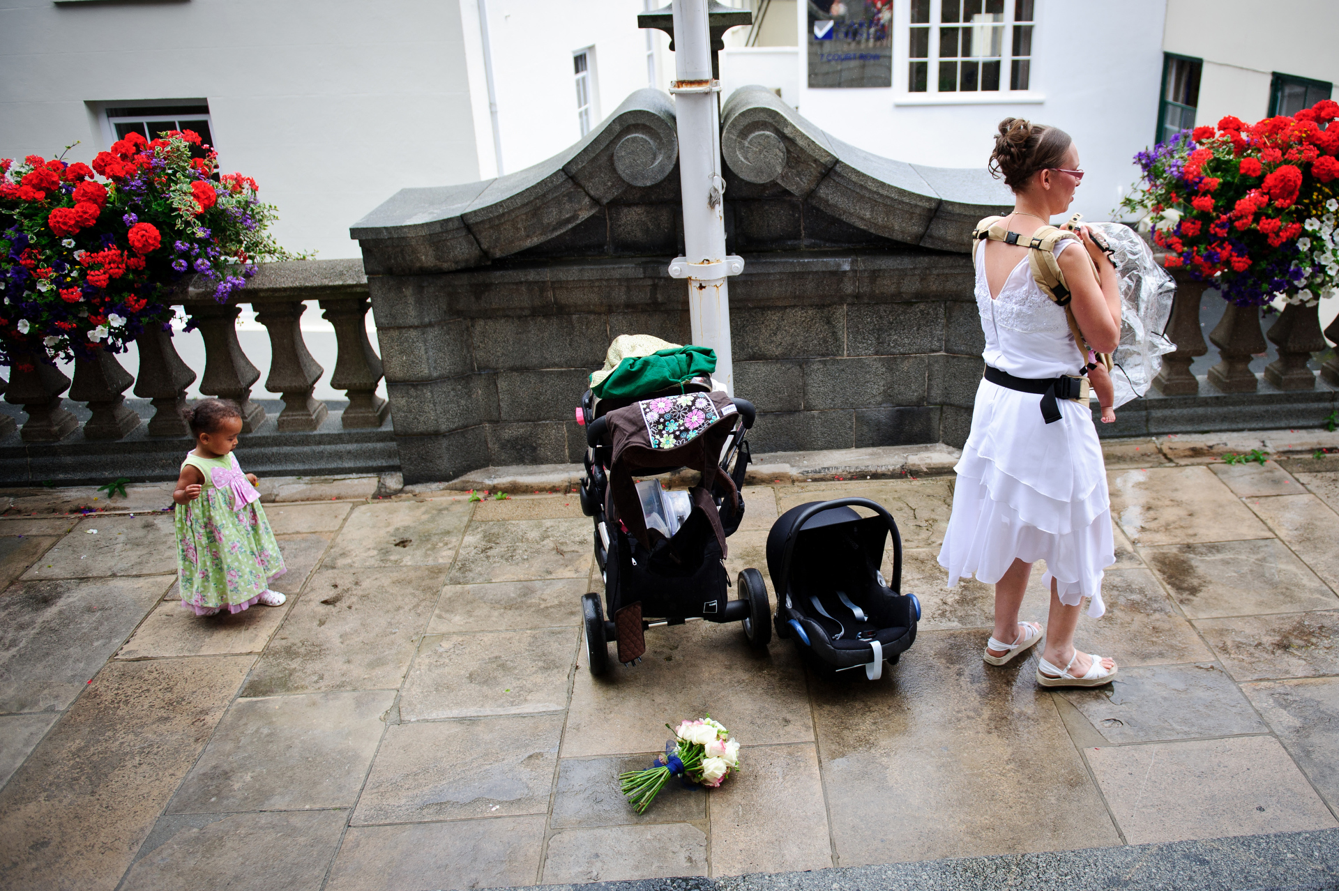 Civil Register Wedding Picture from Guernsey | the bride sets down her bouquet