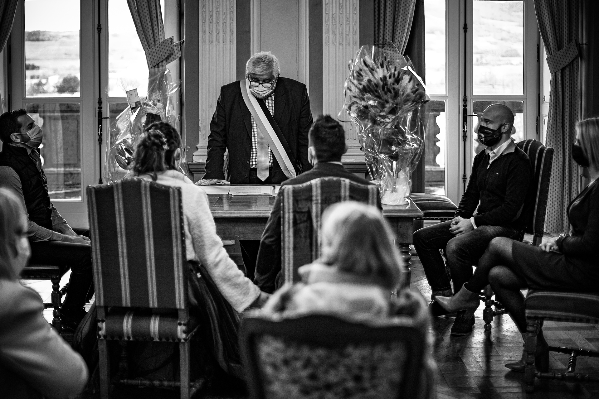 Puy de Dôme Town Hall Wedding Photos | The couple holds hands as the ceremony begins