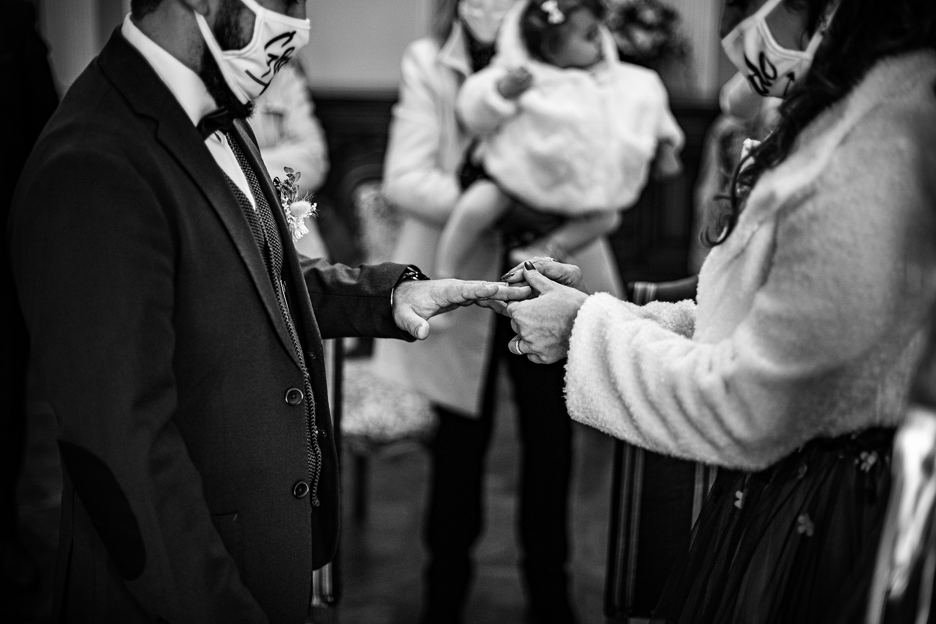 Mairie de Pont du Château Wedding Ceremony Picture | The bride gently places the groom's wedding ring on his finger