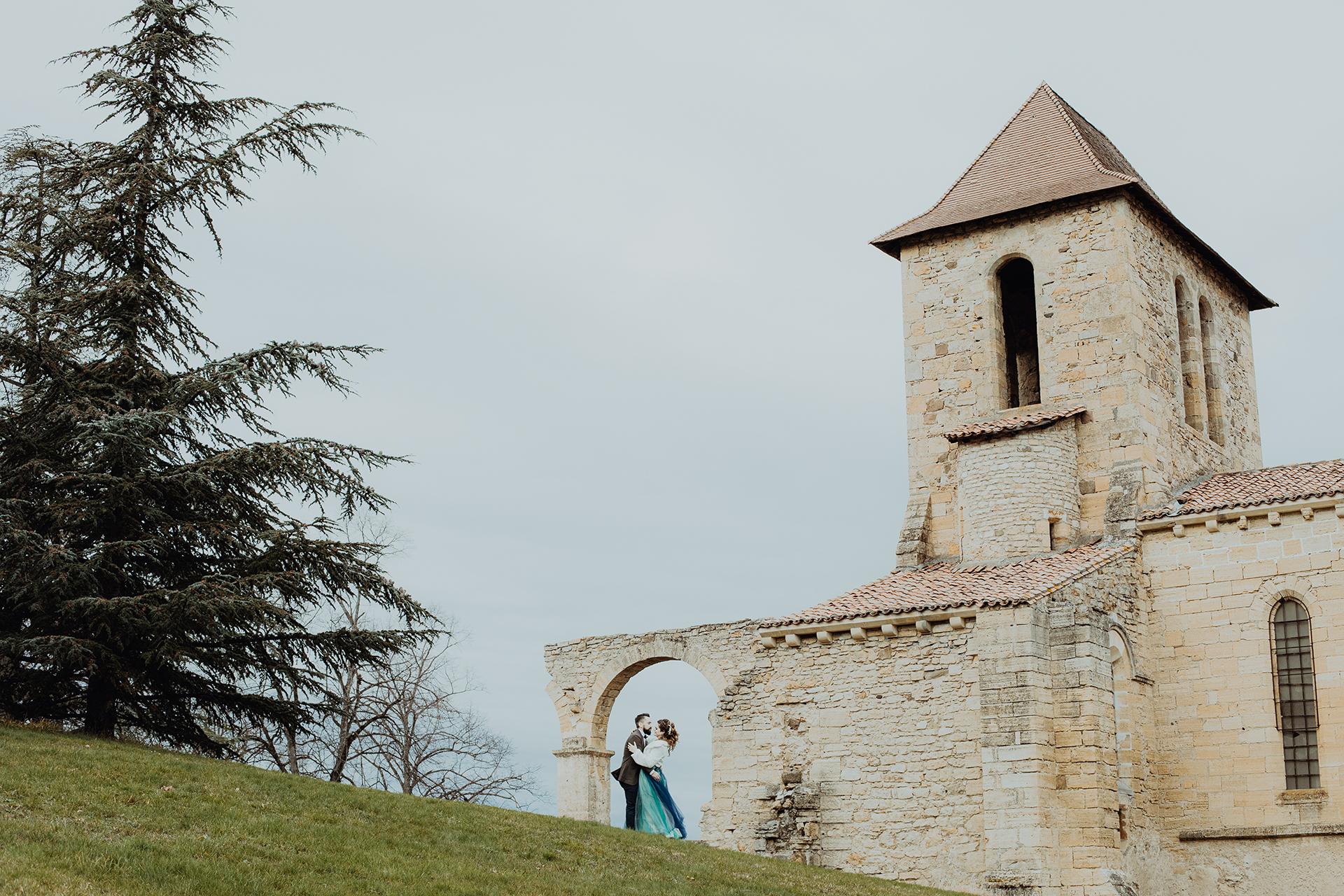 Abandoned Church Puy de Dôme, France Wedding Portraits | The couple poses for a romantic portrait