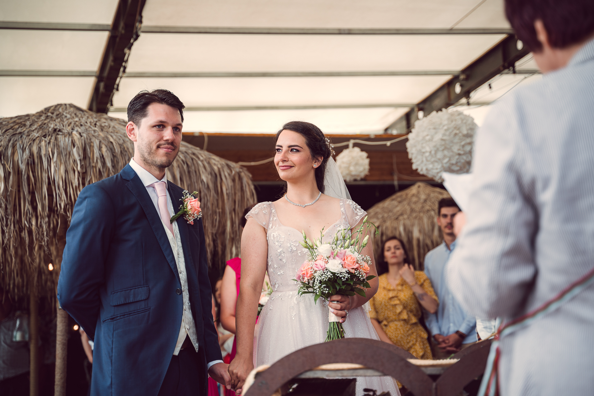 Cozy Bar, Sofia BG Wedding Ceremony Photographer | The bride clasps the grooms hand and looks at him with loving pride