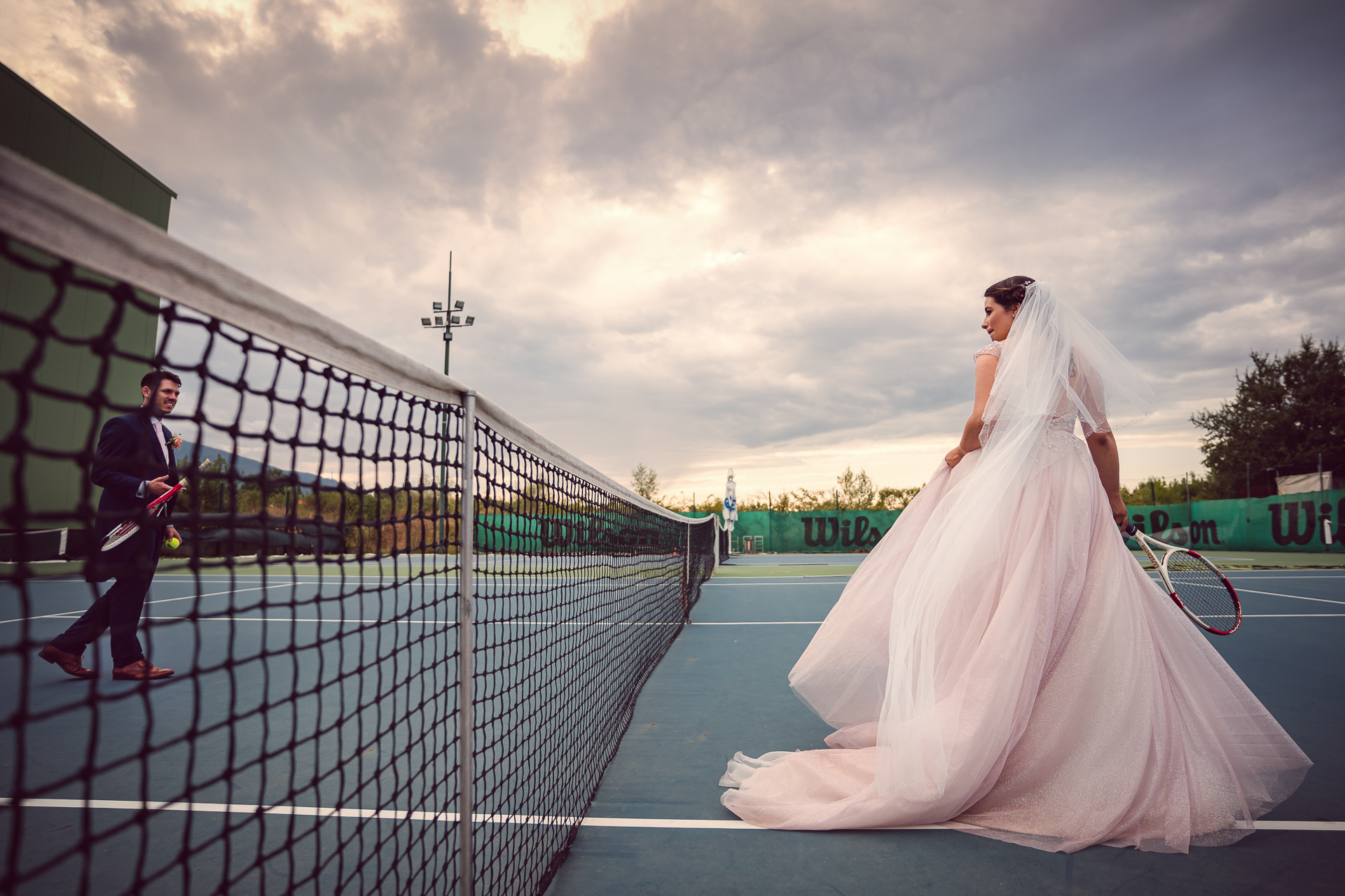 Sofia Wedding Tennis Couple Image | The couple take to the courts while indulging in spontaneity