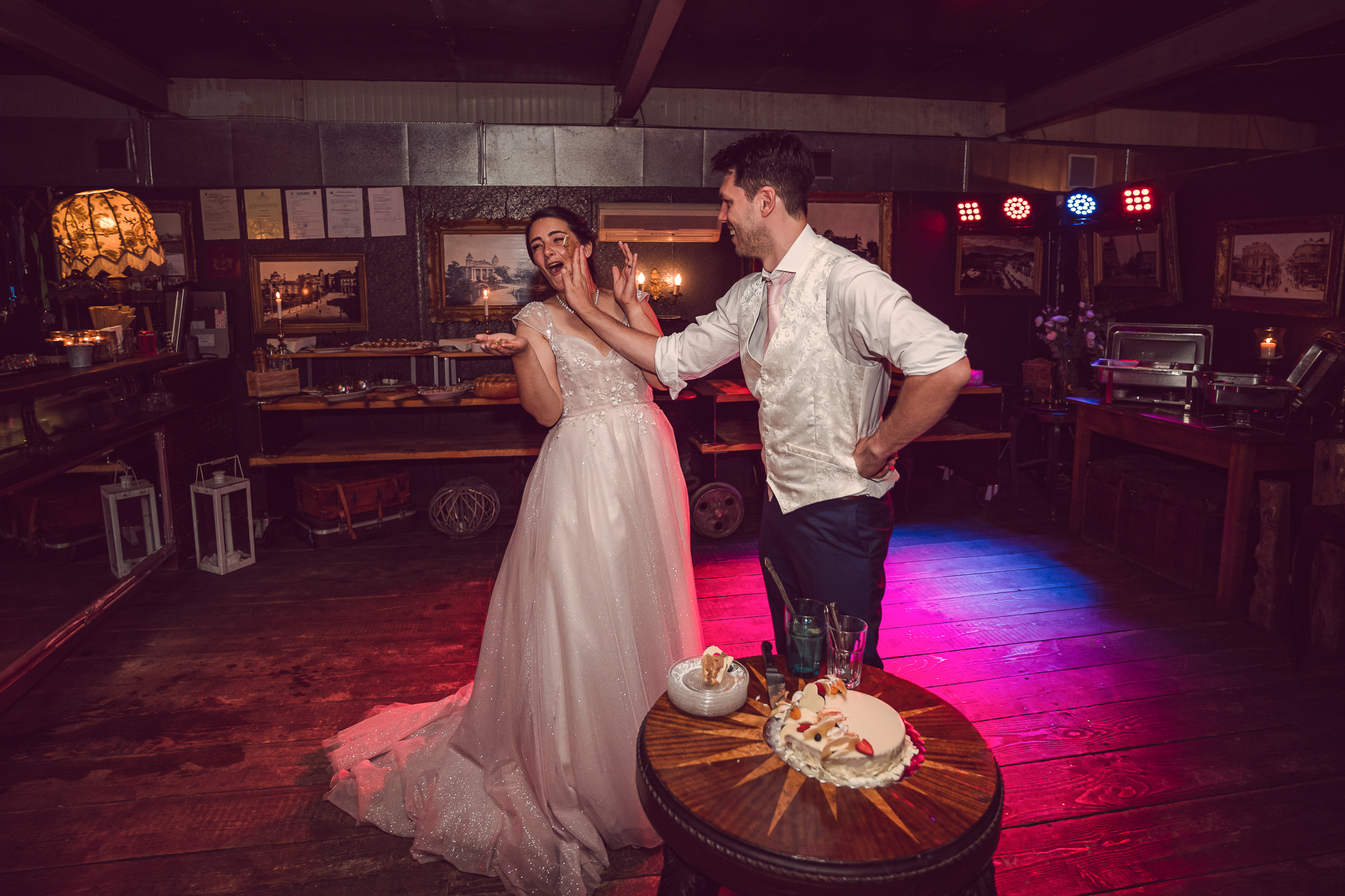 Cozy Bar, Sofia Wedding Reception Venue Image | In the playful atmosphere, the groom smears cake along his bride's cheek