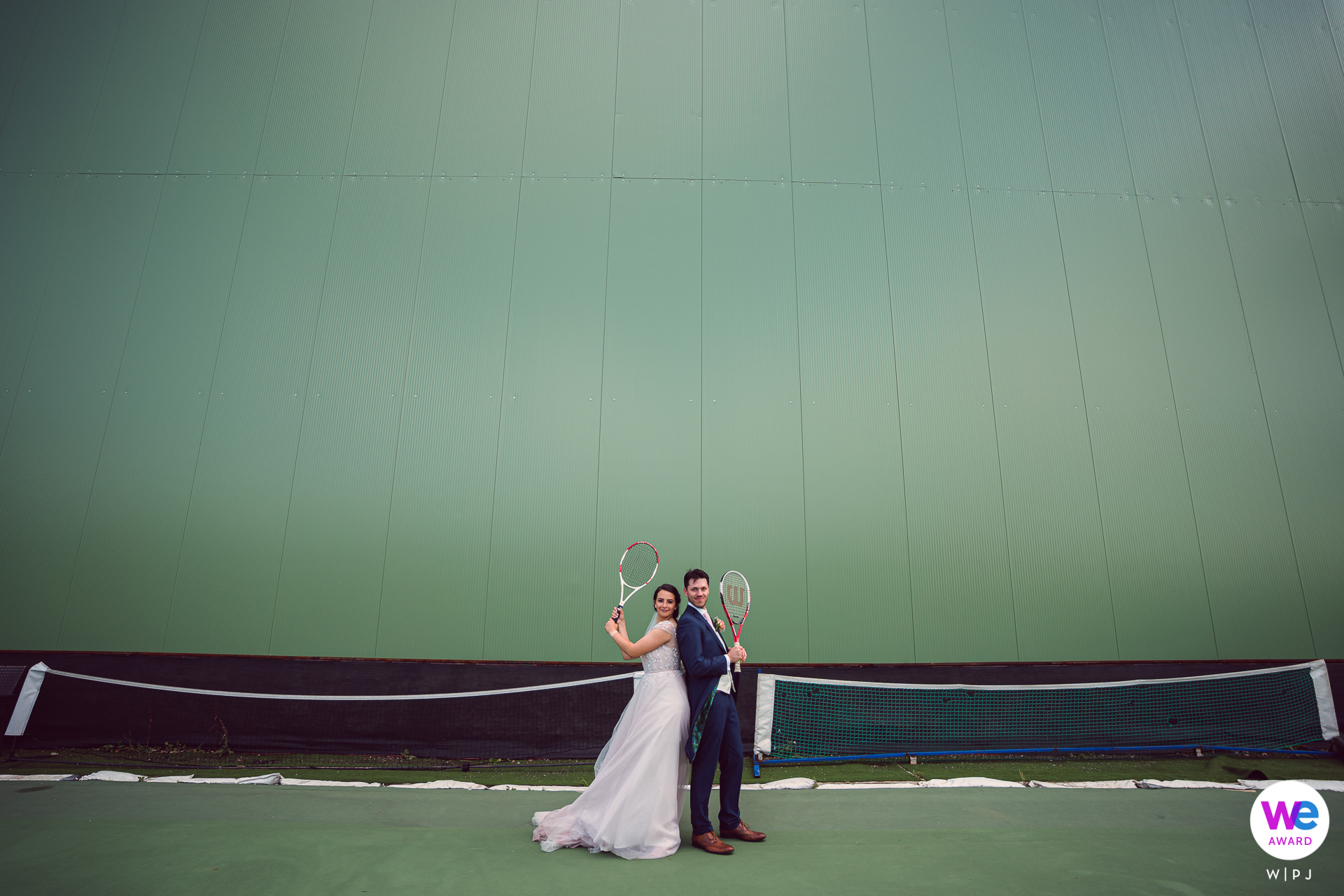 Cozy Bar, Sofia Wedding Day Couple Pic | a lighthearted yet powerful portrait on a tennis court