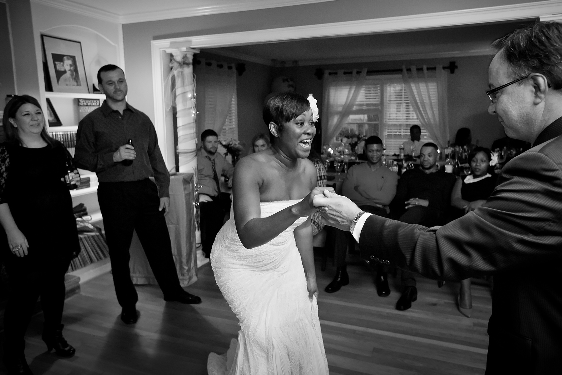 Georgia Wedding Photo - Sandy Springs At Home Wedding | The bride grabs her boss by the hands and pulls him onto the dance floor